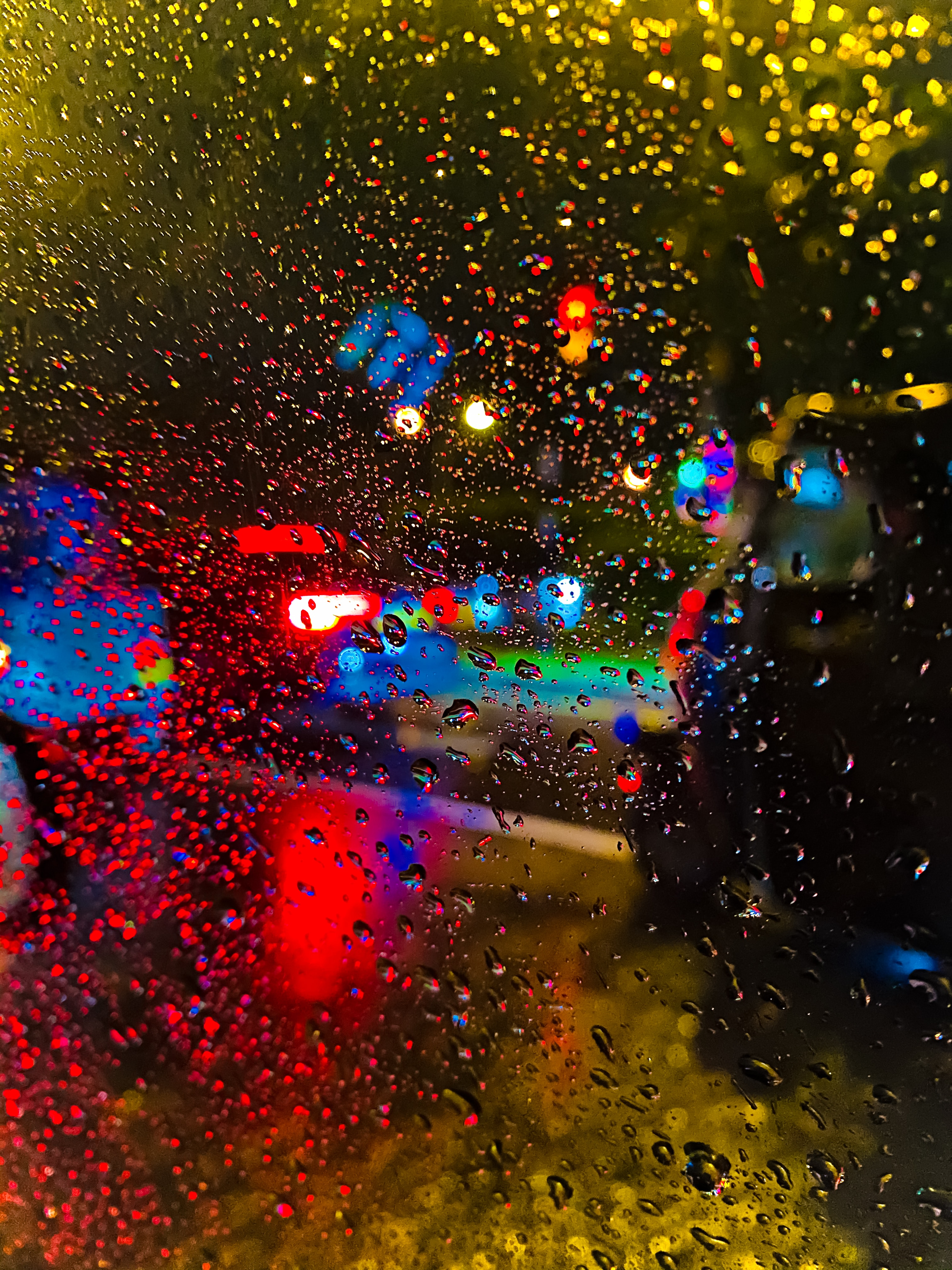 65699 download wallpaper Blur, Rain, Drops, Lights, Macro, Smooth, Glass screensavers and pictures for free
