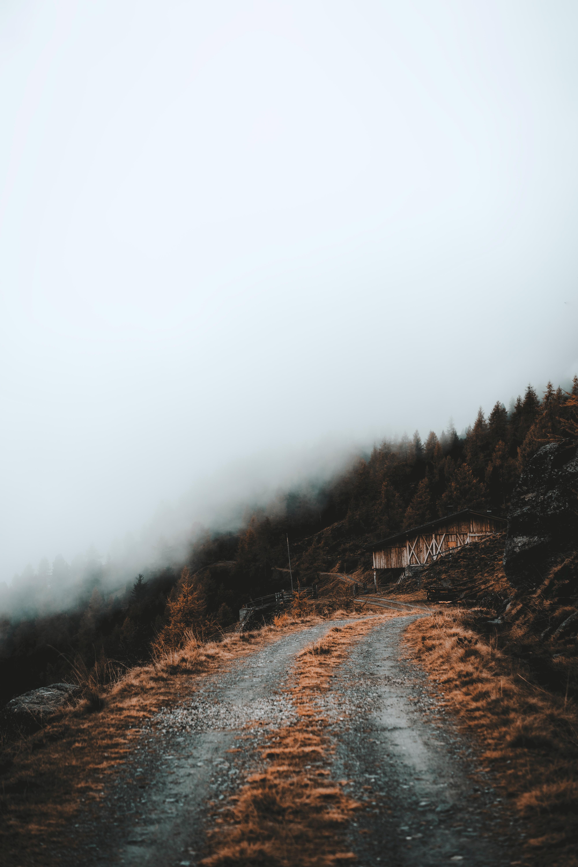129076 免費下載壁紙 性质, 路, 坡, 斜坡, 树, 建造, 建筑, 云, 云端 屏保和圖片