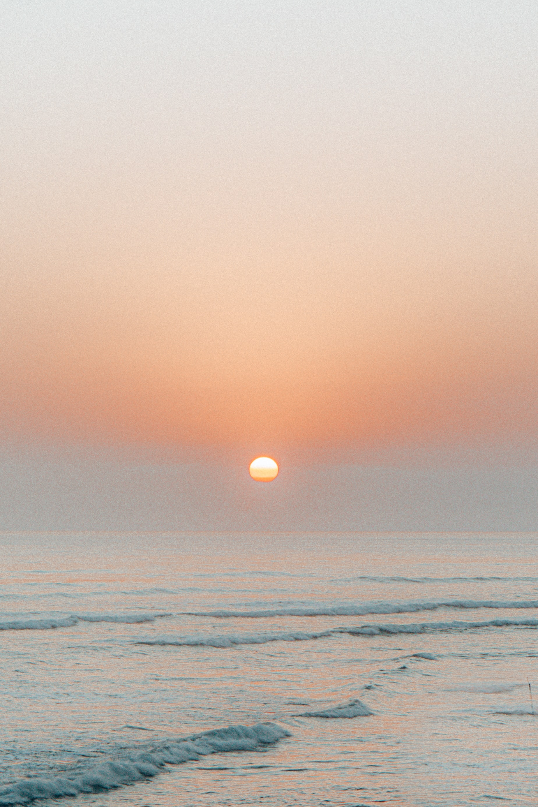 Download mobile wallpaper Nature, Sunset, Sea, Sun, Waves for free.