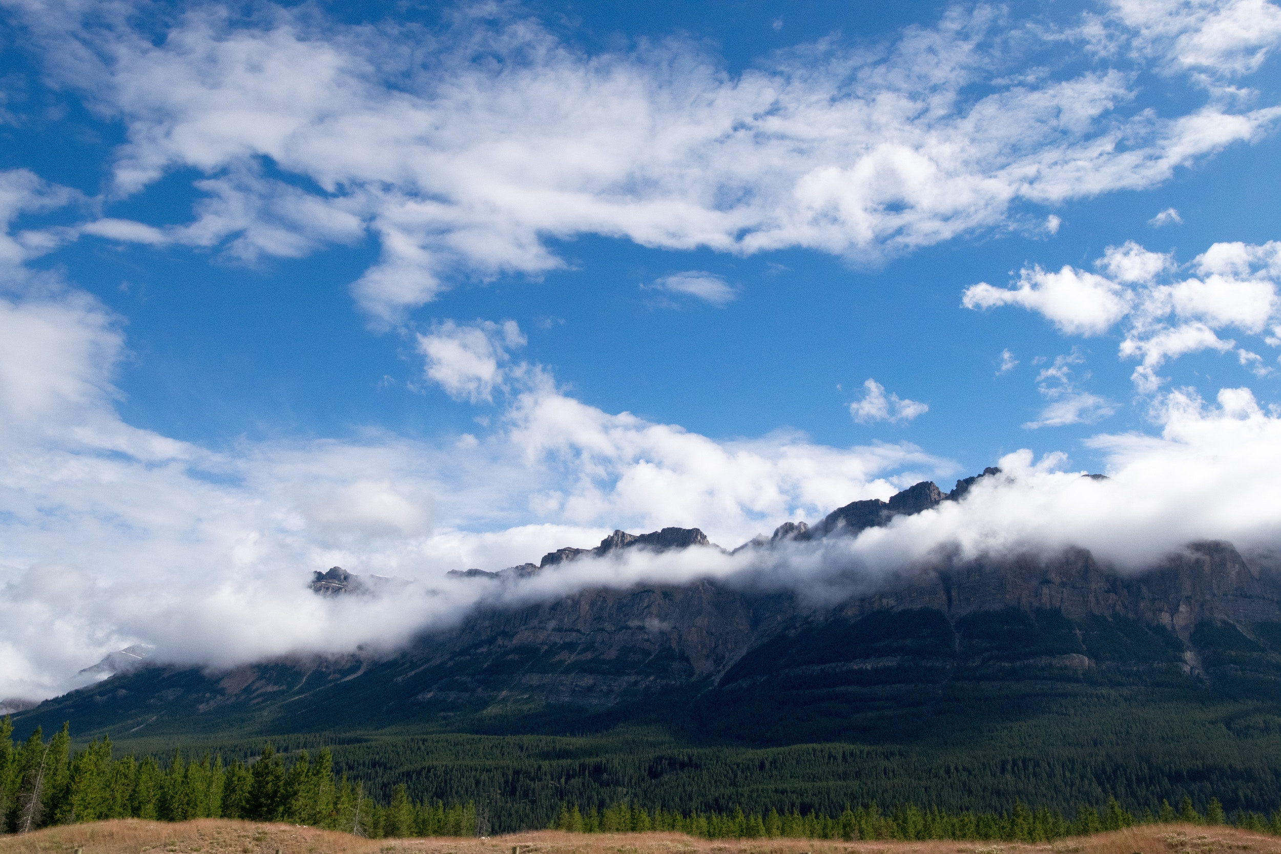 61223 download wallpaper Nature, Clouds, Tops, Vertex, Mountains screensavers and pictures for free