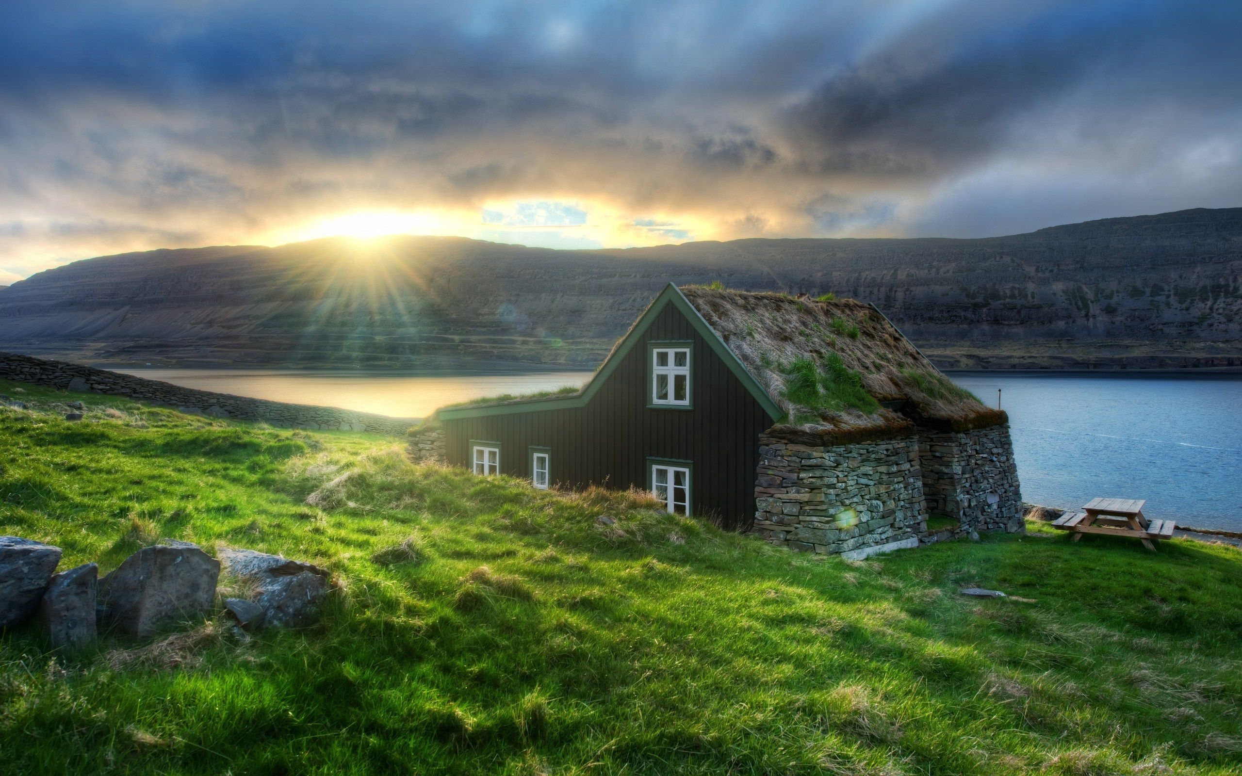 151184 download wallpaper Nature, Iceland, House, Stones, Sunset, Lake, Hermit, Mountains screensavers and pictures for free