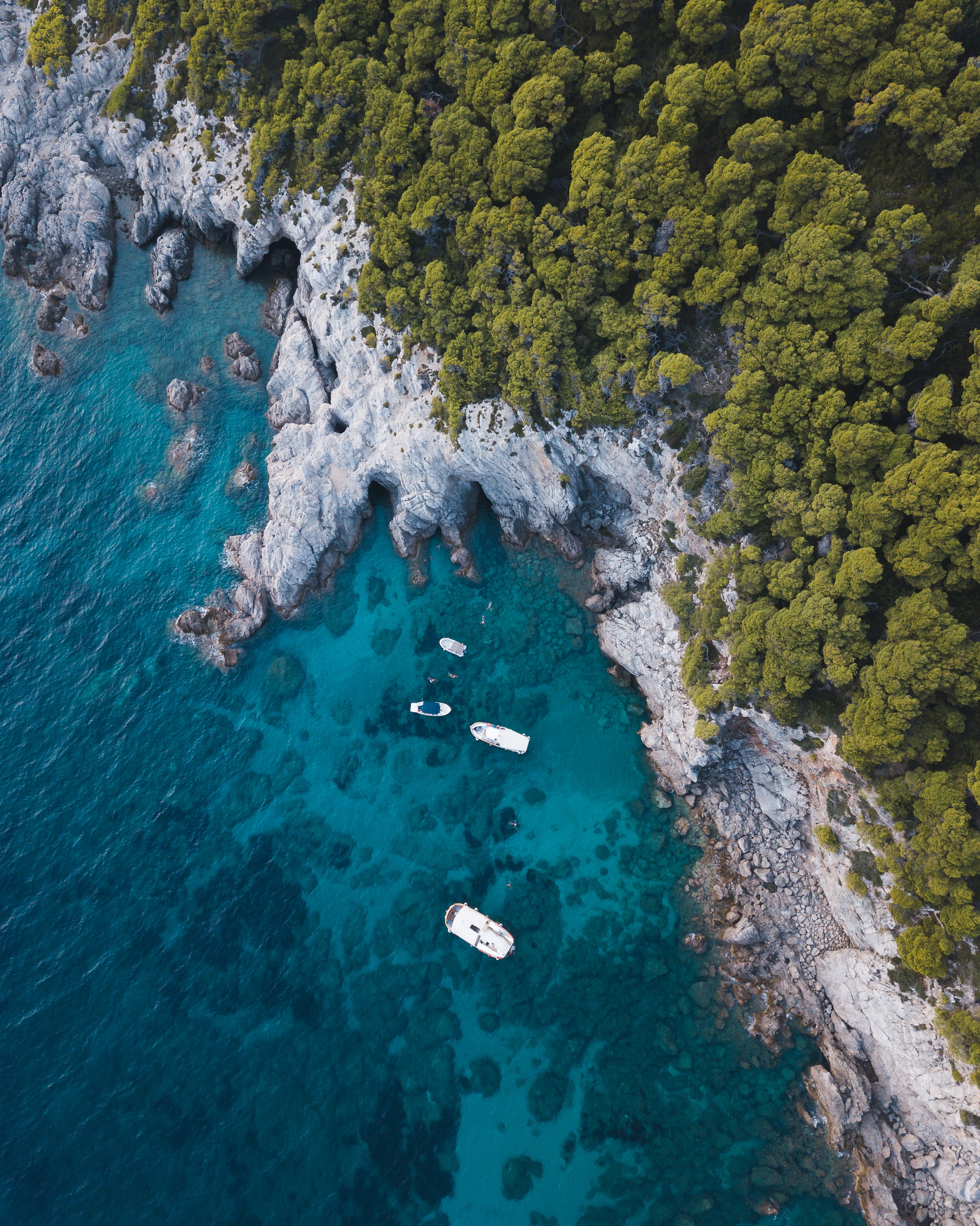 149792 download wallpaper Nature, Sea, Rocks, View From Above, Coast, Boat screensavers and pictures for free