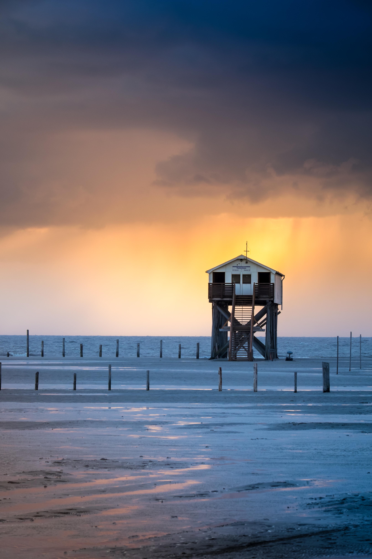 155541 скачать обои Природа, Здание, Пляж, Море, Закат - заставки и картинки бесплатно