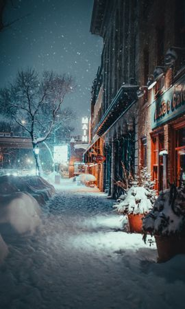 Free wallpaper 128617: City, Evening, Snowfall, Winter, Street, Building, Cities download pictures for cellphone