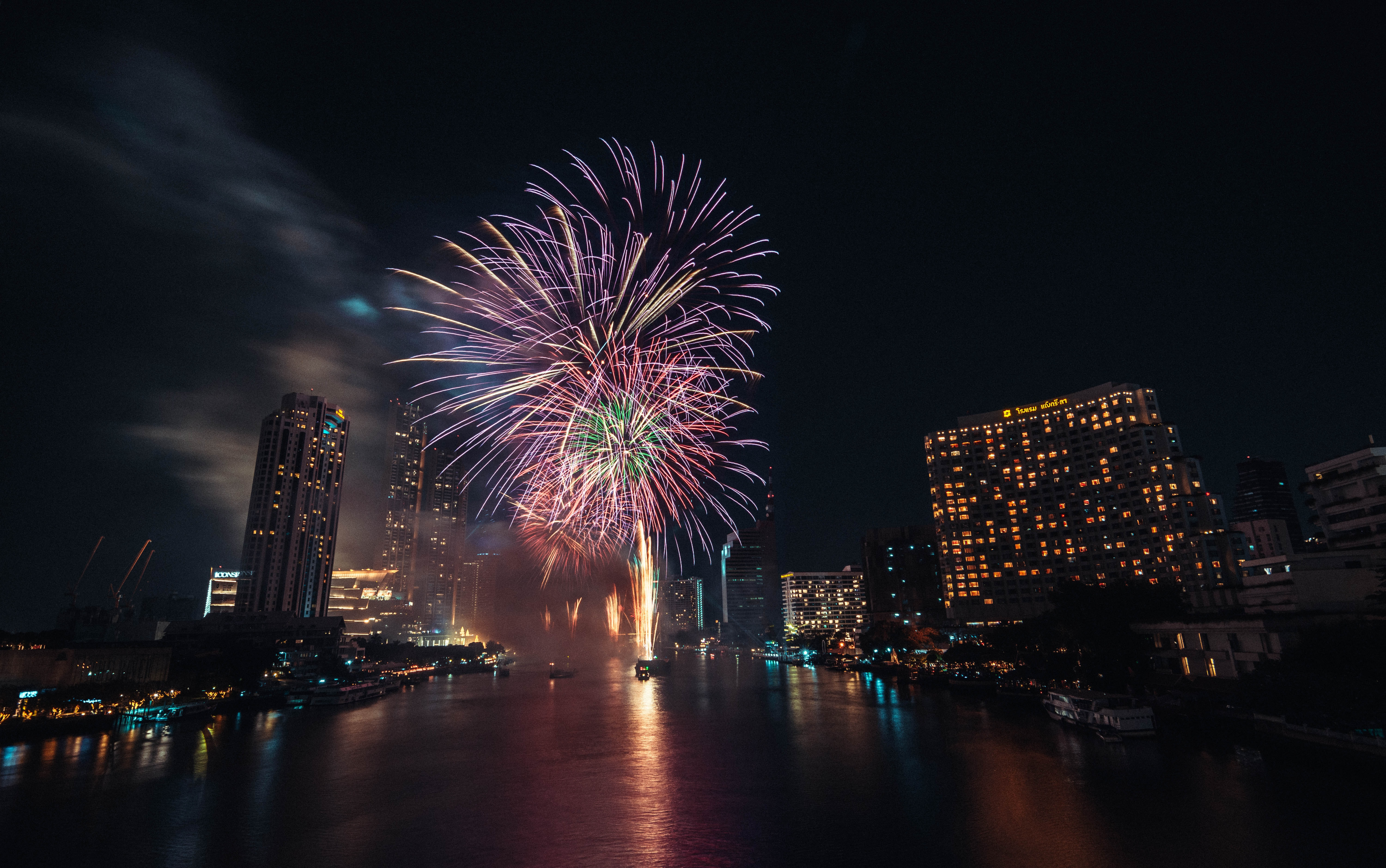 155567 download wallpaper Holidays, Water, Explosions, City, Sparks, Holiday, Fireworks, Firework screensavers and pictures for free