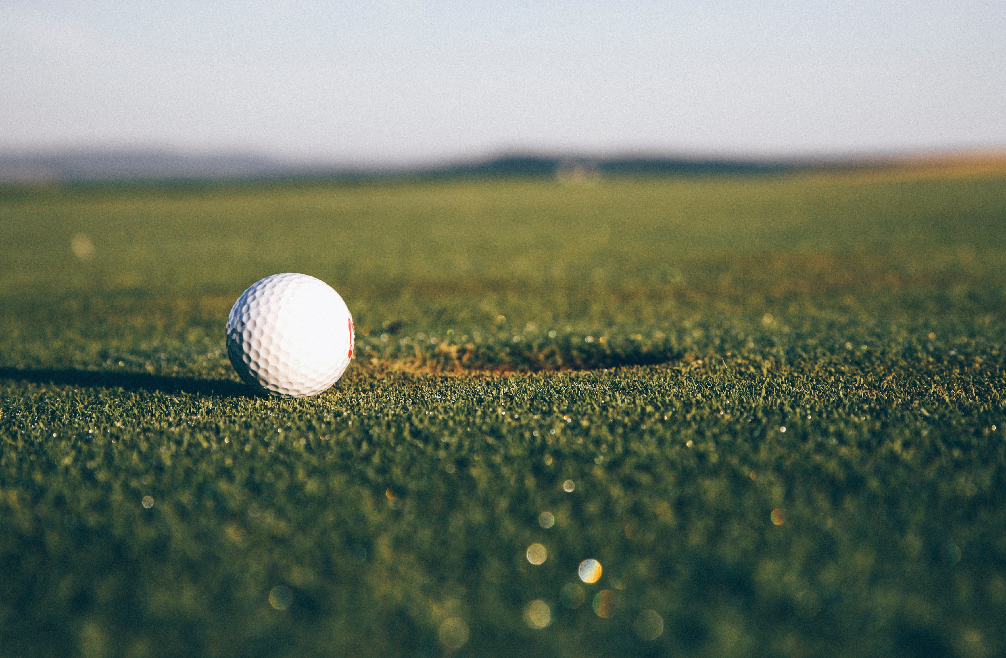97220 download wallpaper Sports, Golf, Ball, Lawn, Hole screensavers and pictures for free