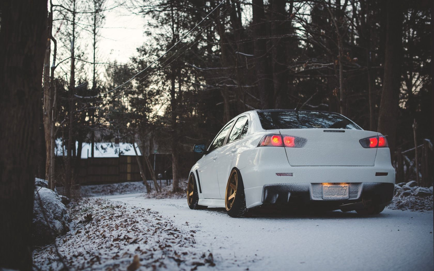 145570 download wallpaper Cars, Mitsubishi, Lancer, Back View, Rear View, Winter screensavers and pictures for free