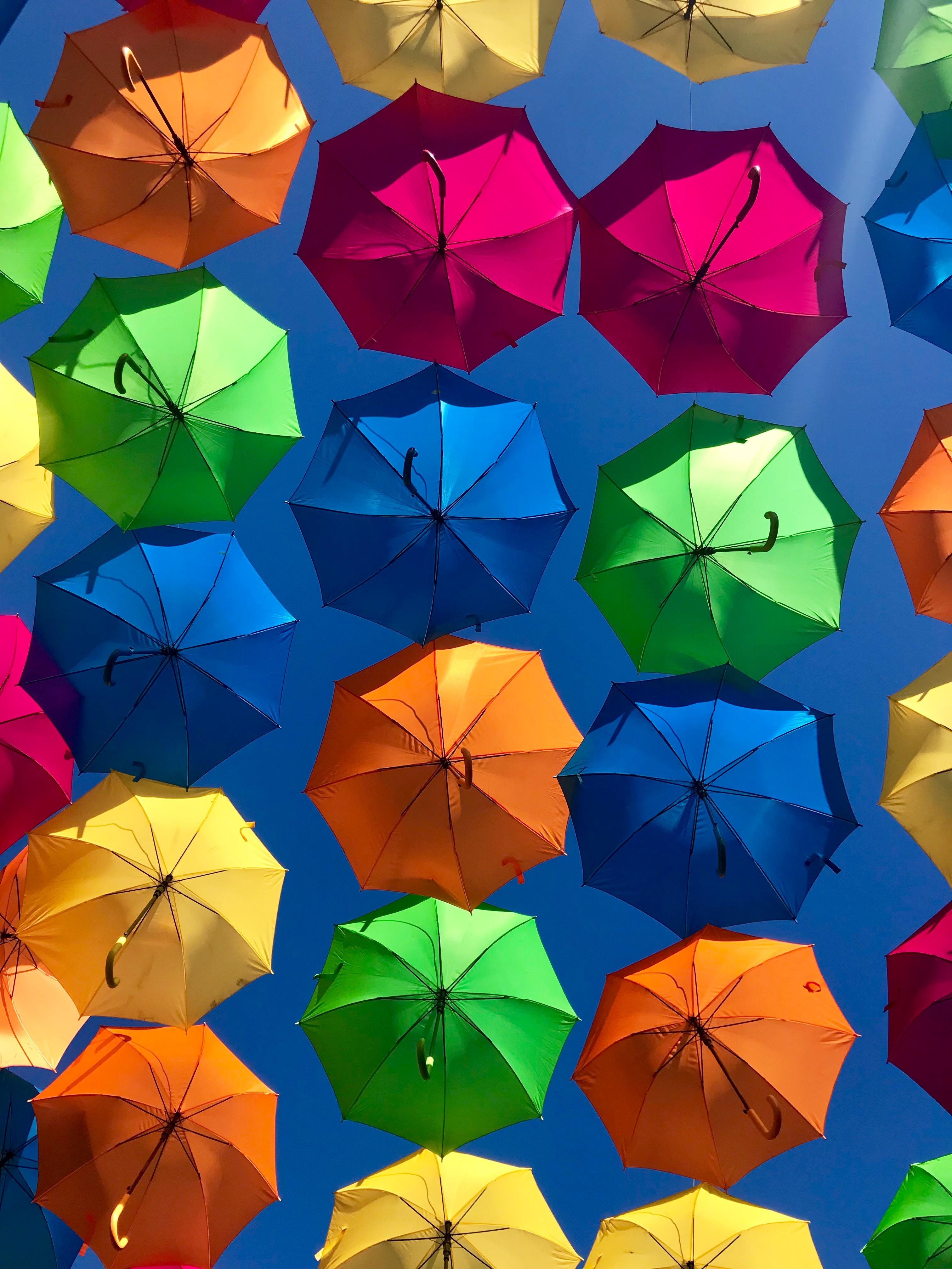 145878 download wallpaper Multicolored, Sky, Miscellanea, Miscellaneous, Motley, Sunny, Umbrellas screensavers and pictures for free