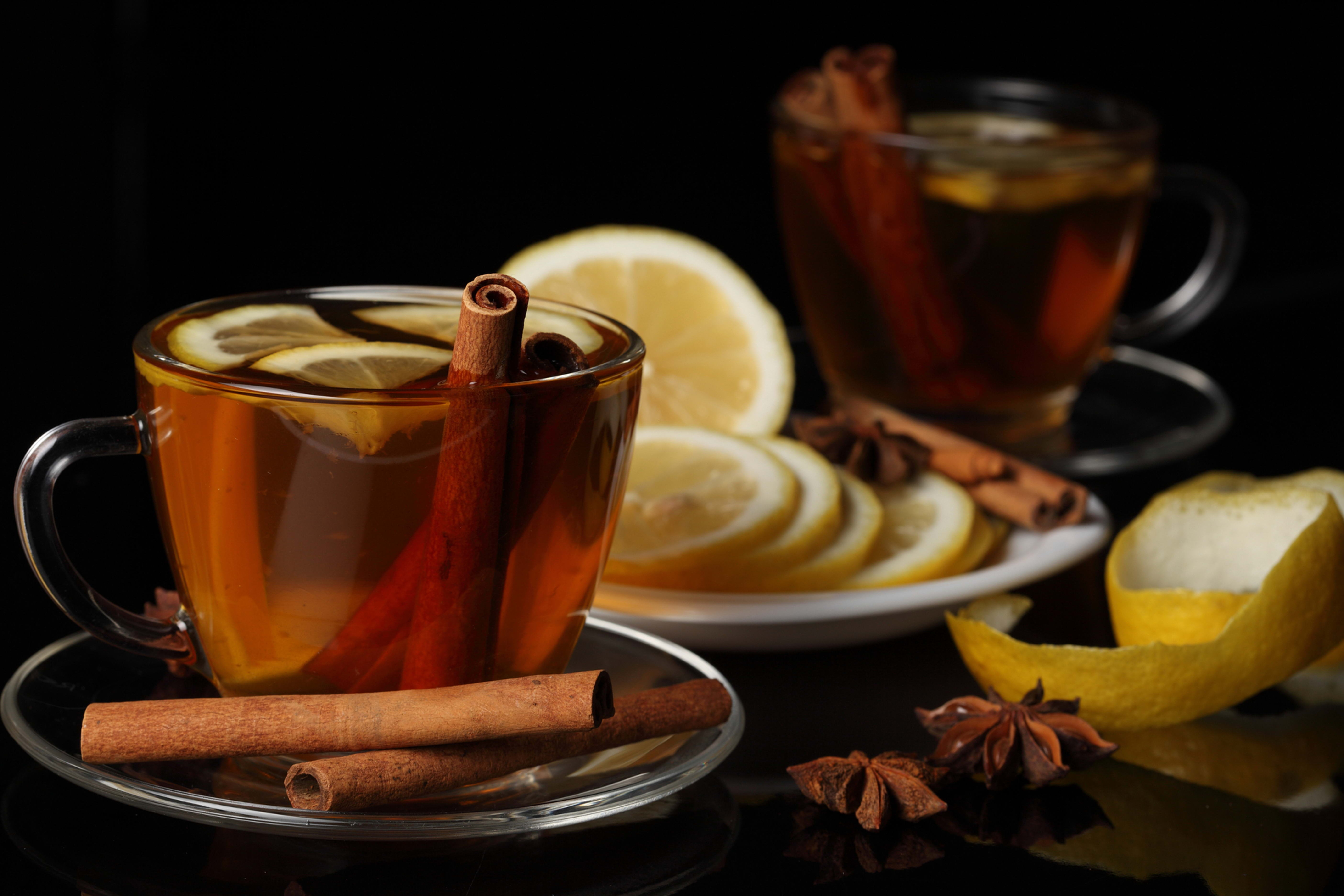 102913 download wallpaper Food, Tea, Cup, Lemon, Black Background, Cinnamon screensavers and pictures for free