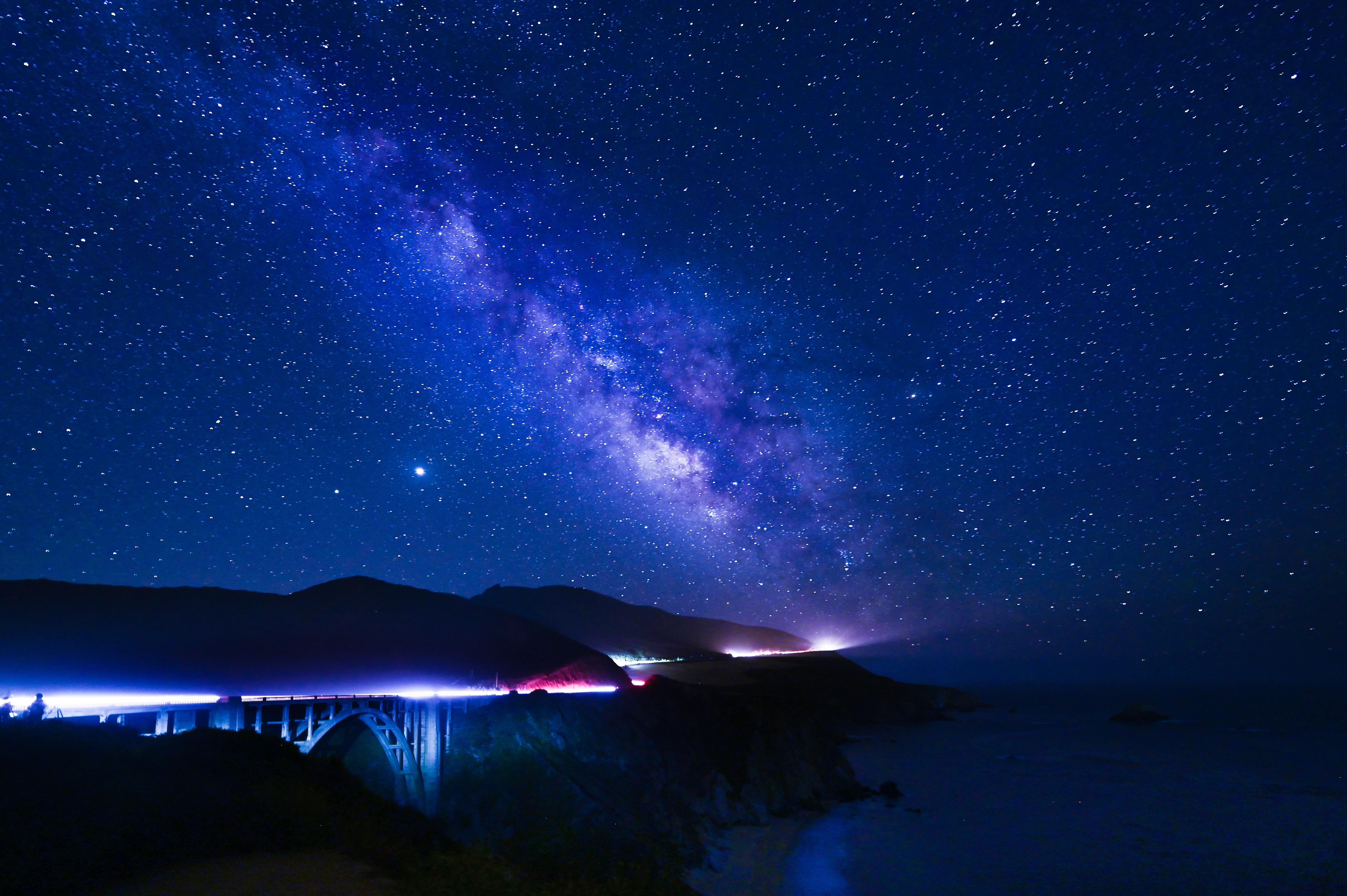 57555 download wallpaper Bridges, Night, Dark, Hills, Nebula, Neon, Glow screensavers and pictures for free