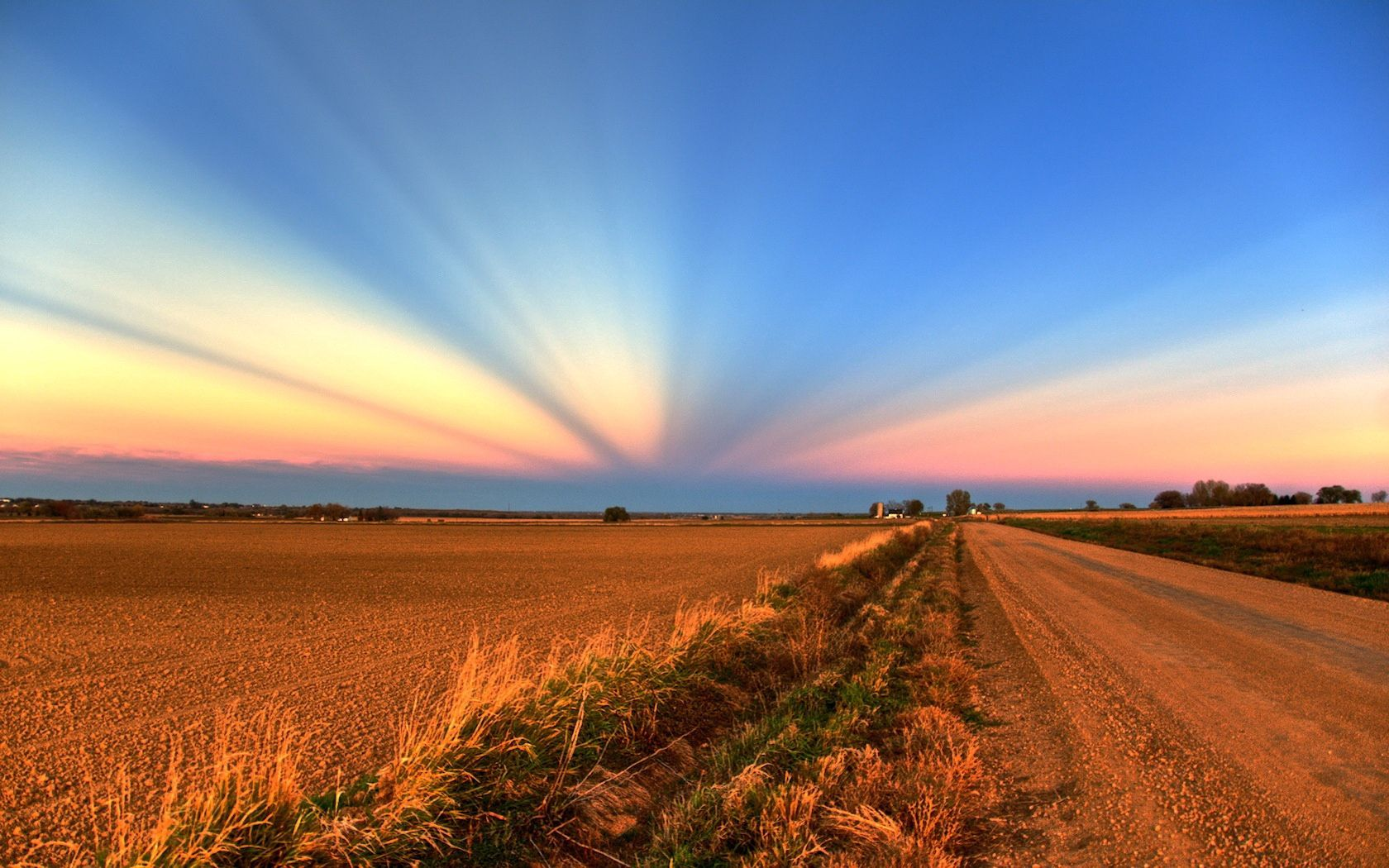 140097 Screensavers and Wallpapers Agriculture for phone. Download Nature, Sunset, Beams, Rays, Road, Field, Evening, Agriculture, Crops pictures for free
