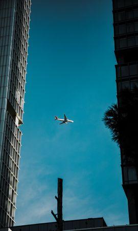 Скачать бесплатно картинку 74350: Разное, Самолет, Небо, Здания, Вид Снизу, Архитектура обои на телефон