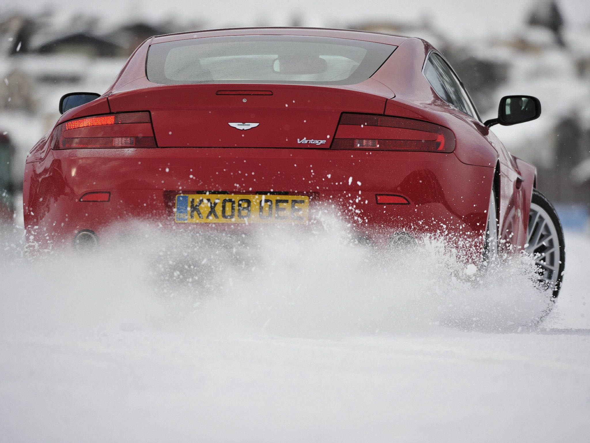 154198 download wallpaper Snow, Aston Martin, Cars, Back View, Rear View, Style, 2008, V8, Drift screensavers and pictures for free