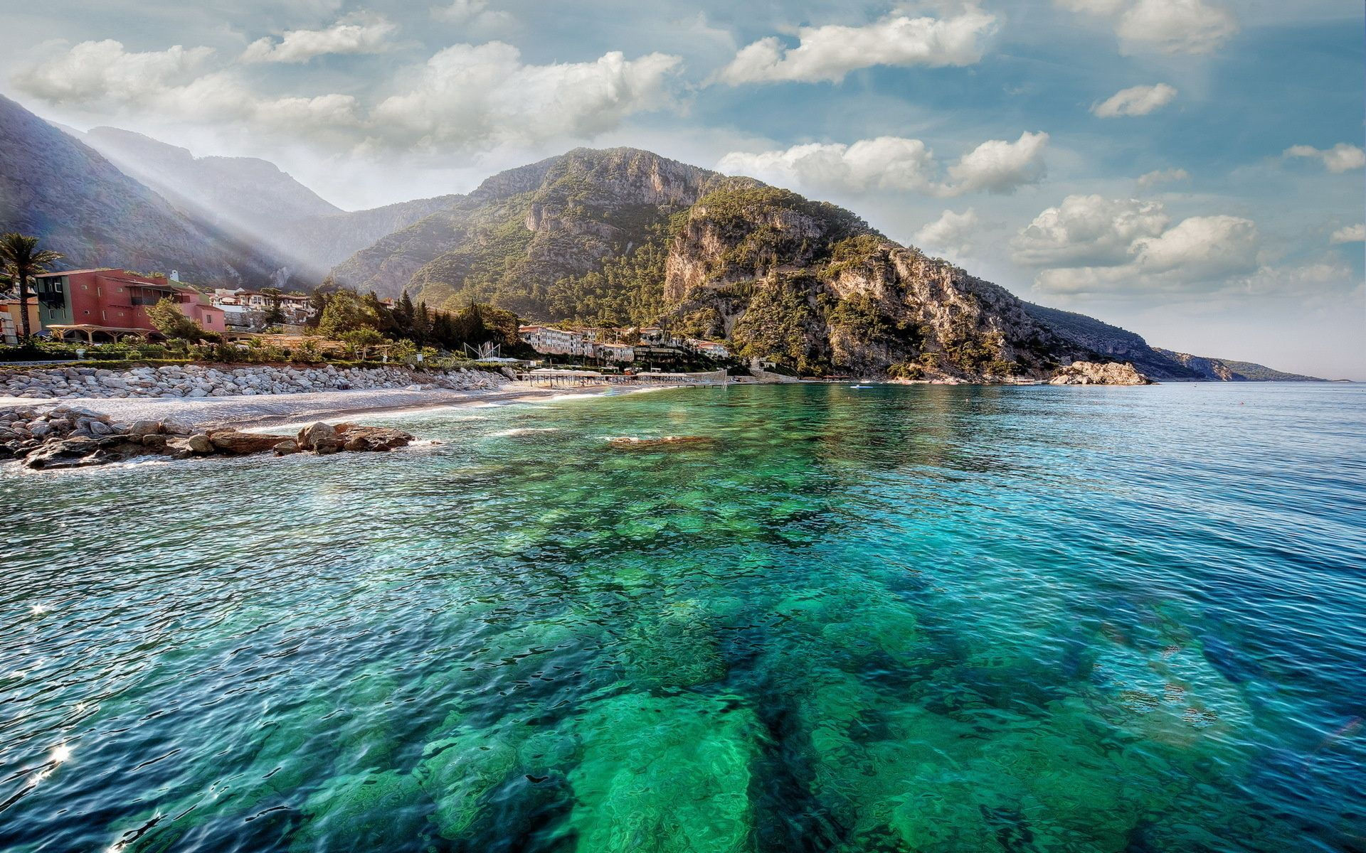 120296 Screensavers and Wallpapers Island for phone. Download Nature, Water, Mountains, Sun, Shore, Bank, Transparent, Shine, Light, Island, Reefs, Bottom pictures for free