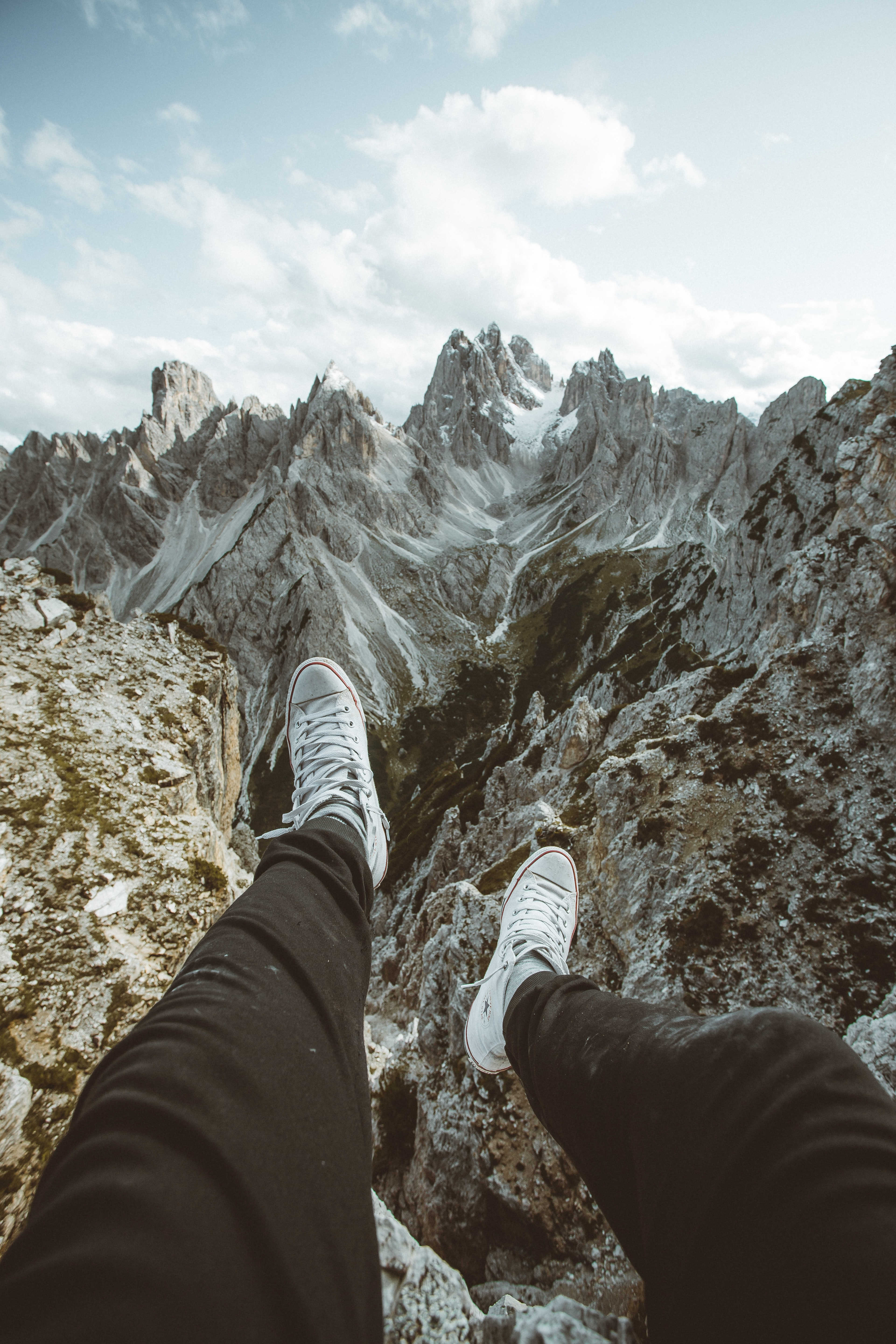 142517 download wallpaper Miscellanea, Miscellaneous, Legs, Sneakers, Shoes, Mountains screensavers and pictures for free