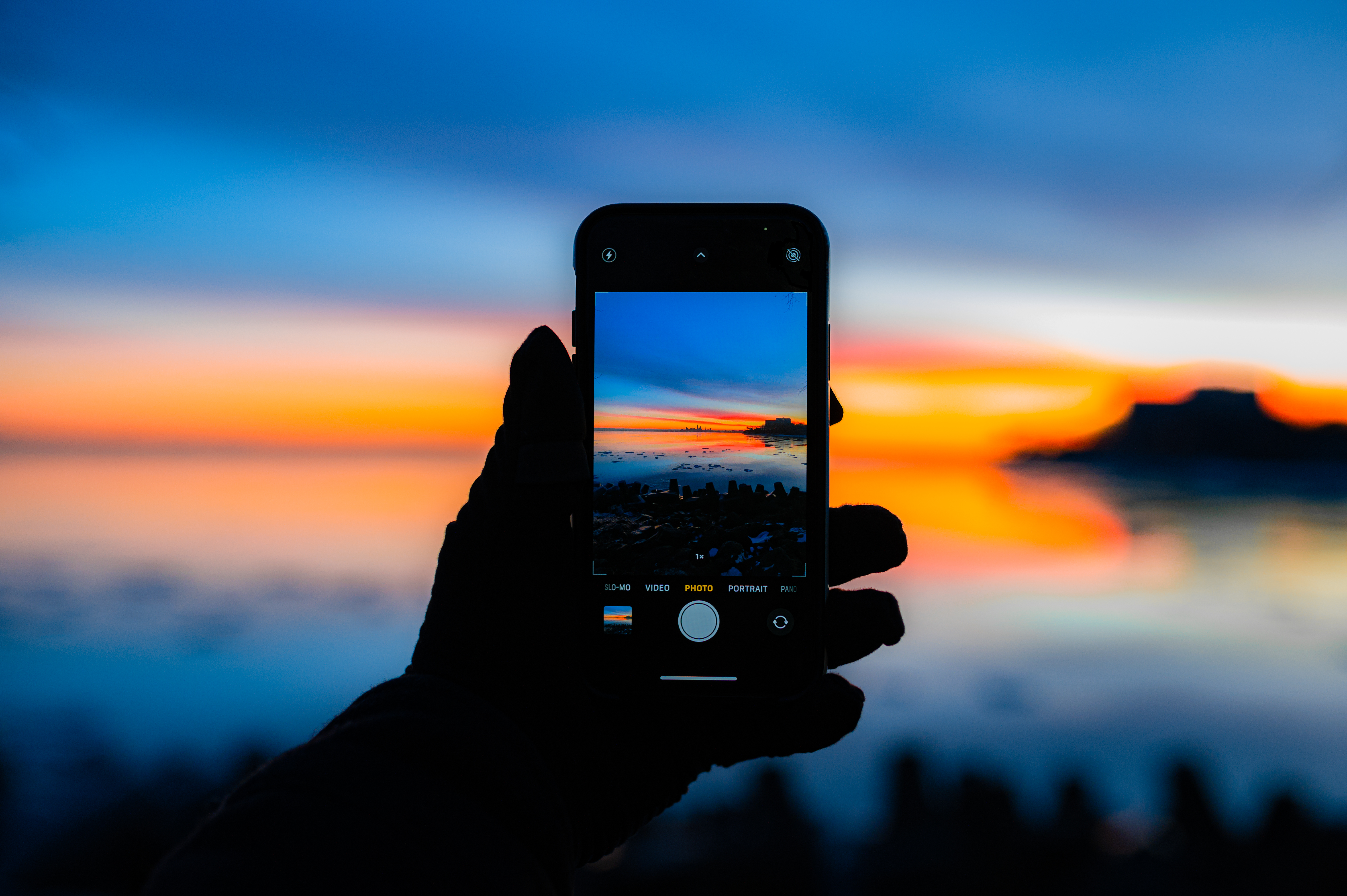 109975 Screensavers and Wallpapers Photo for phone. Download Dark, Telephone, Hand, Photo, Sunset pictures for free
