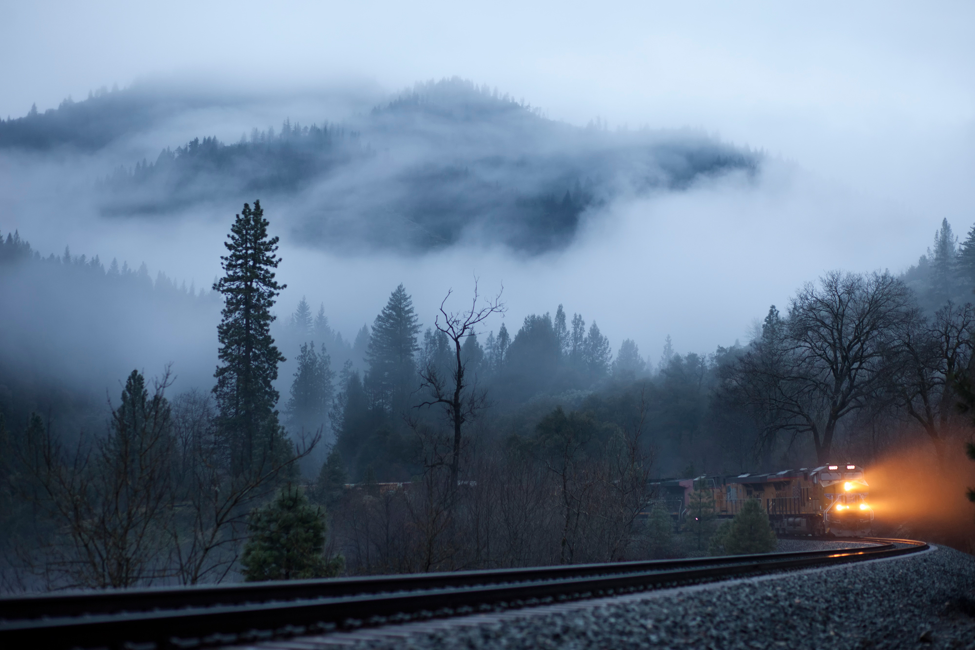 94156 download wallpaper Light, Nature, Trees, Shine, Fog, Railway, Train screensavers and pictures for free