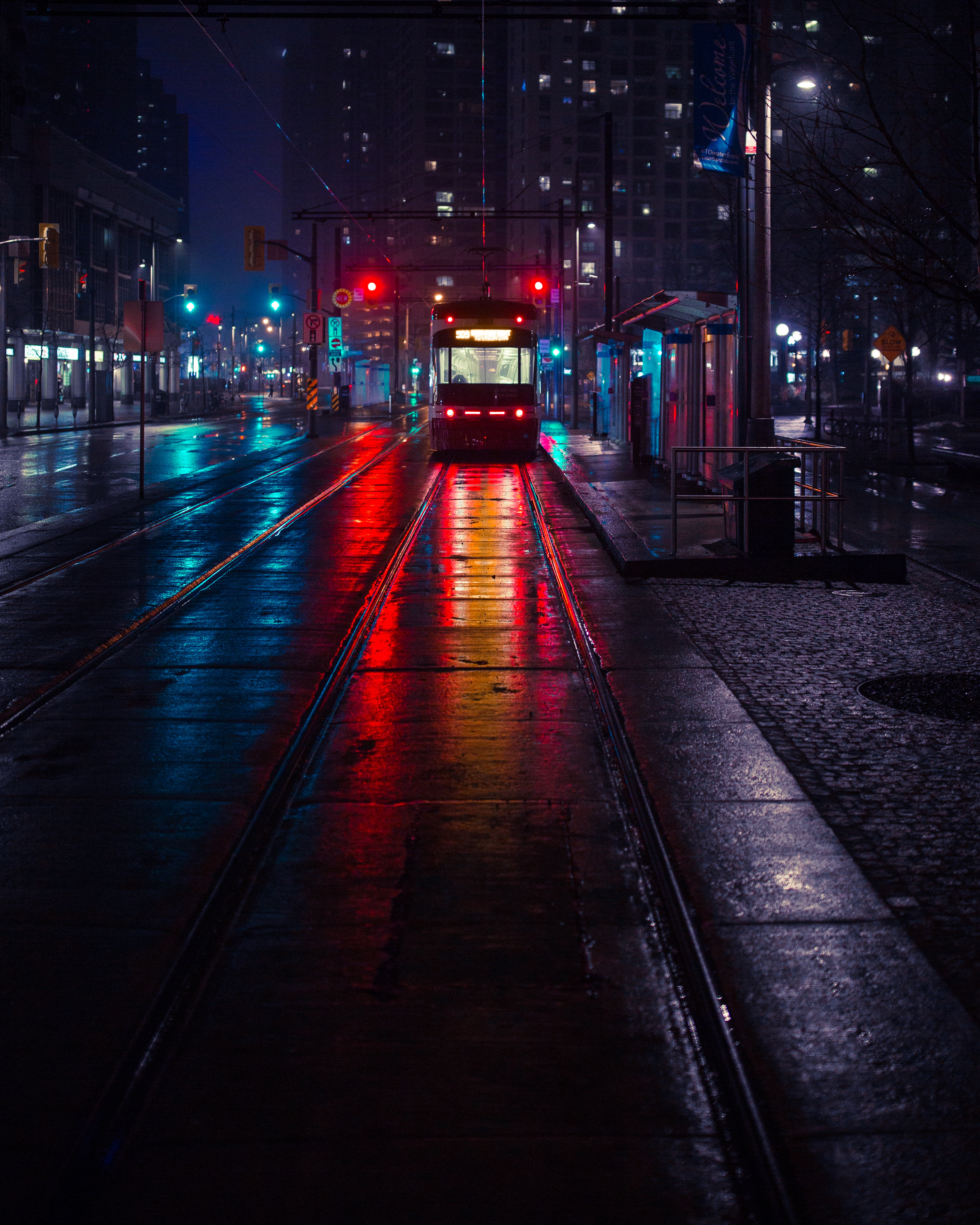 78664 Screensavers and Wallpapers Cities for phone. Download Evening, Cities, City, Illumination, Lighting, Stop, Trolleybus pictures for free