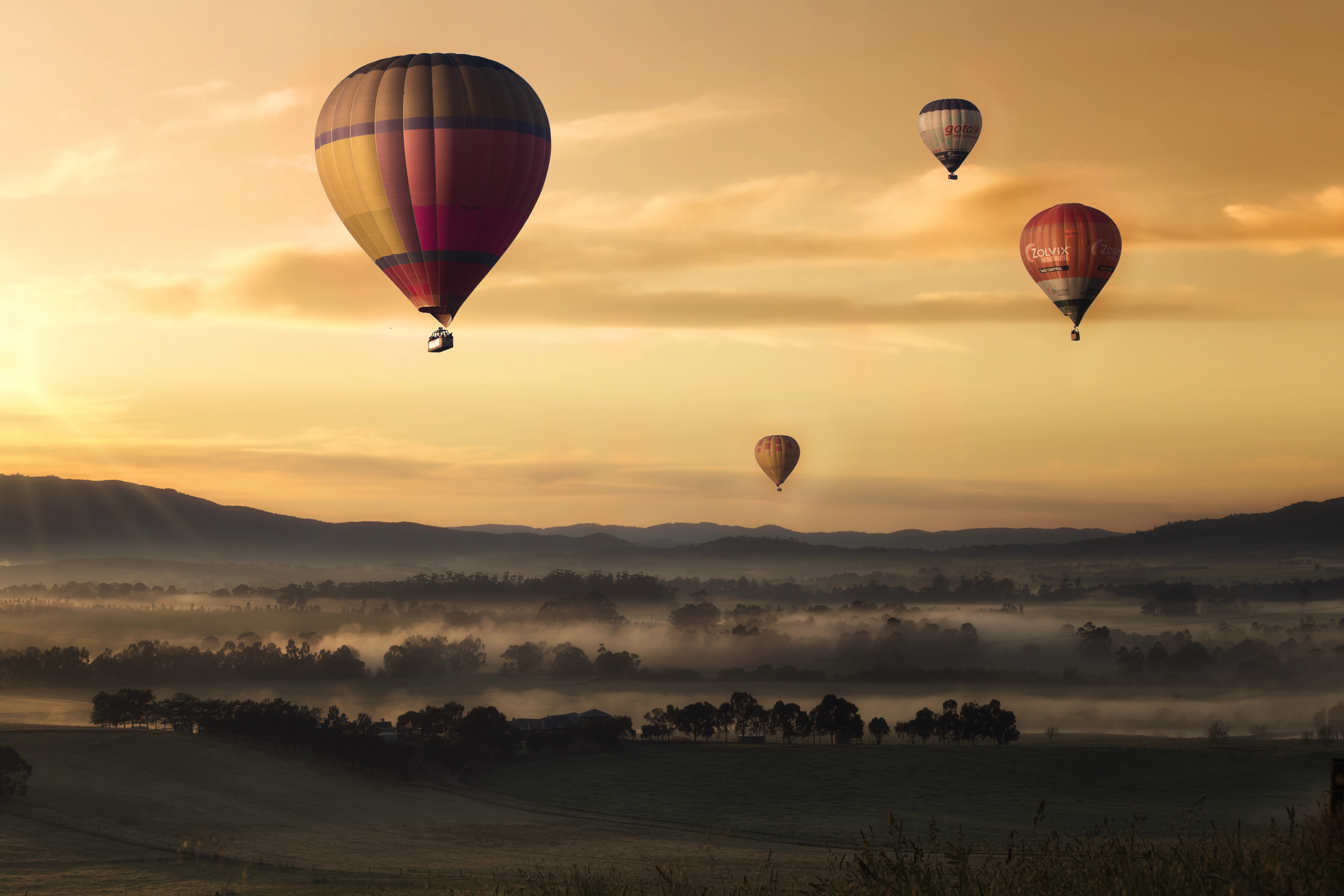 87361 Screensavers and Wallpapers Balloons for phone. Download Nature, Sunset, Sky, Balloons, Fog, Field pictures for free