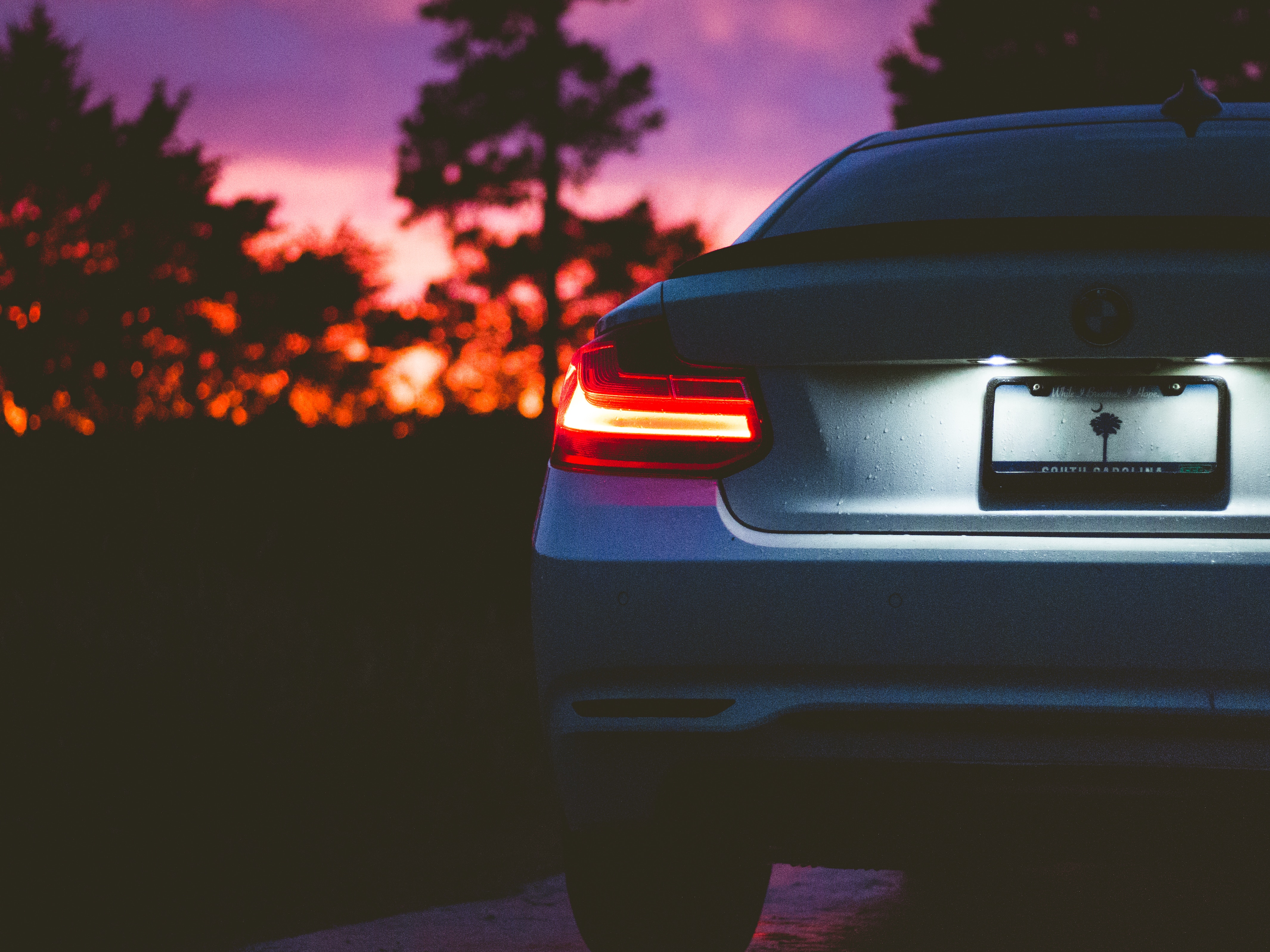 130583 download wallpaper Cars, Bmw, Back View, Rear View, Headlight, Sunset, Shine, Light screensavers and pictures for free