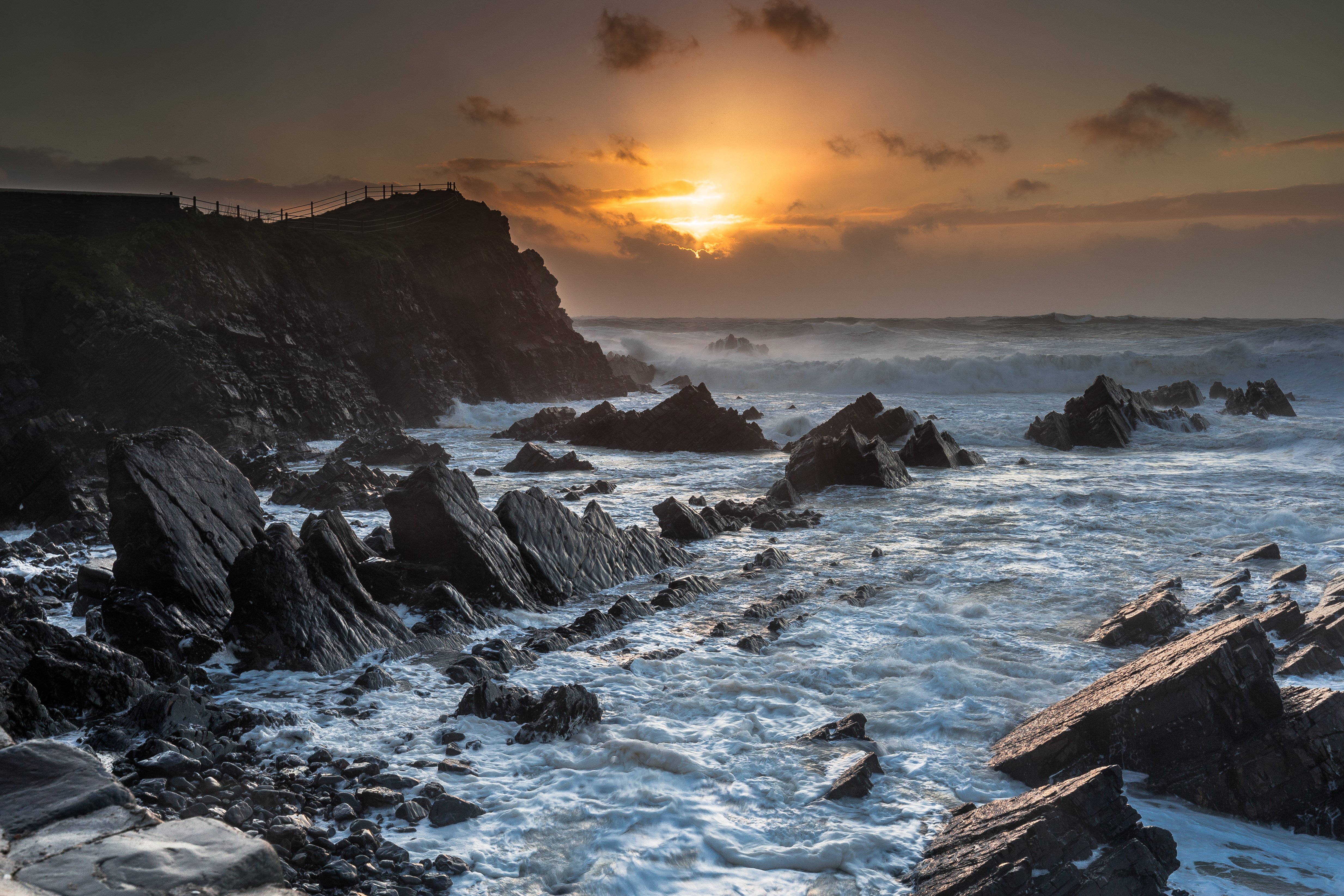139988 download wallpaper Nature, Sunset, Sea, Rocks, Waves, Landscape screensavers and pictures for free