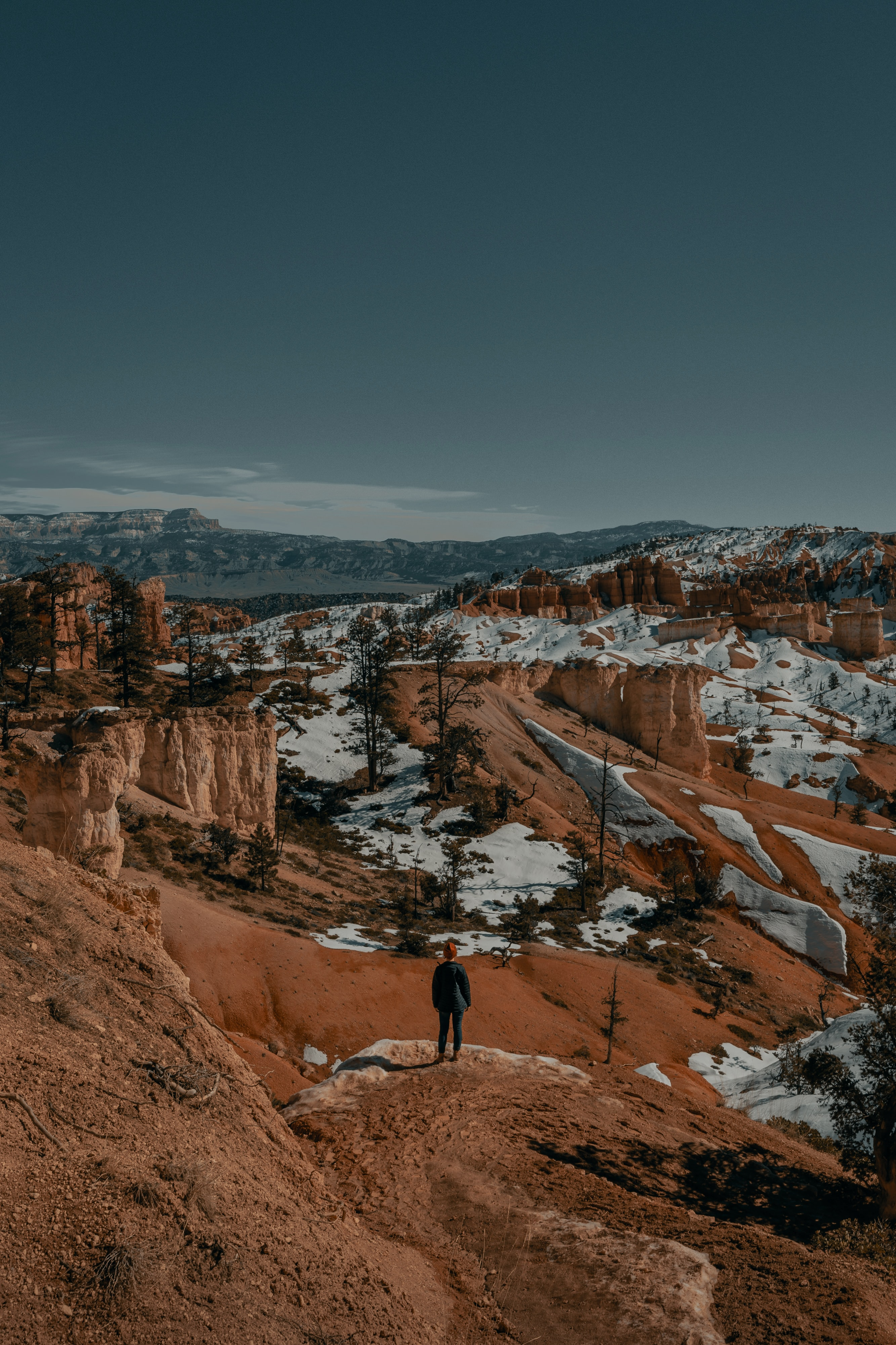 144863 download wallpaper Miscellanea, Miscellaneous, Human, Person, Loneliness, Canyon, Rocks, Snow screensavers and pictures for free