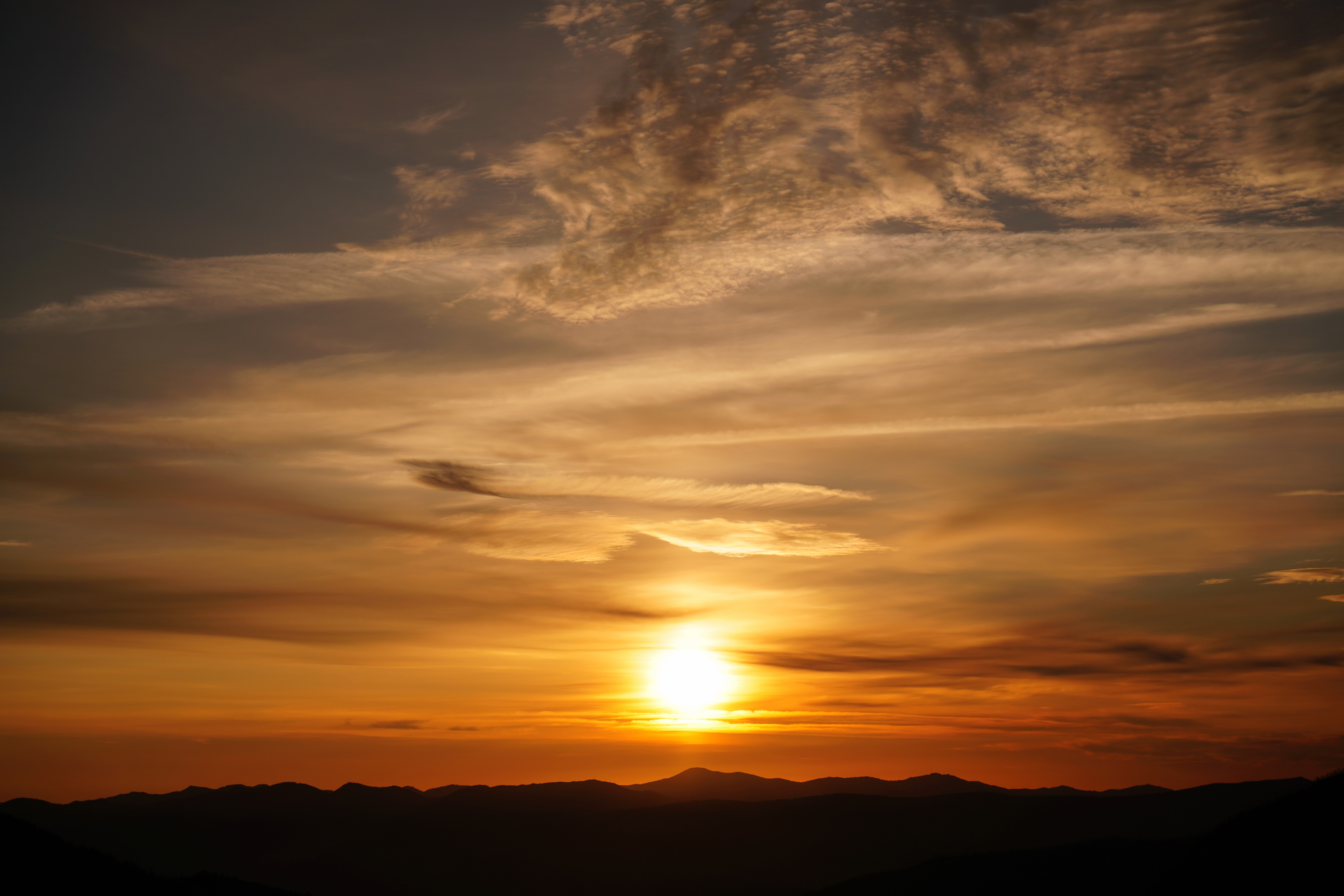 108228 download wallpaper Nature, Sunset, Clouds, Hills, Sky, Sun screensavers and pictures for free