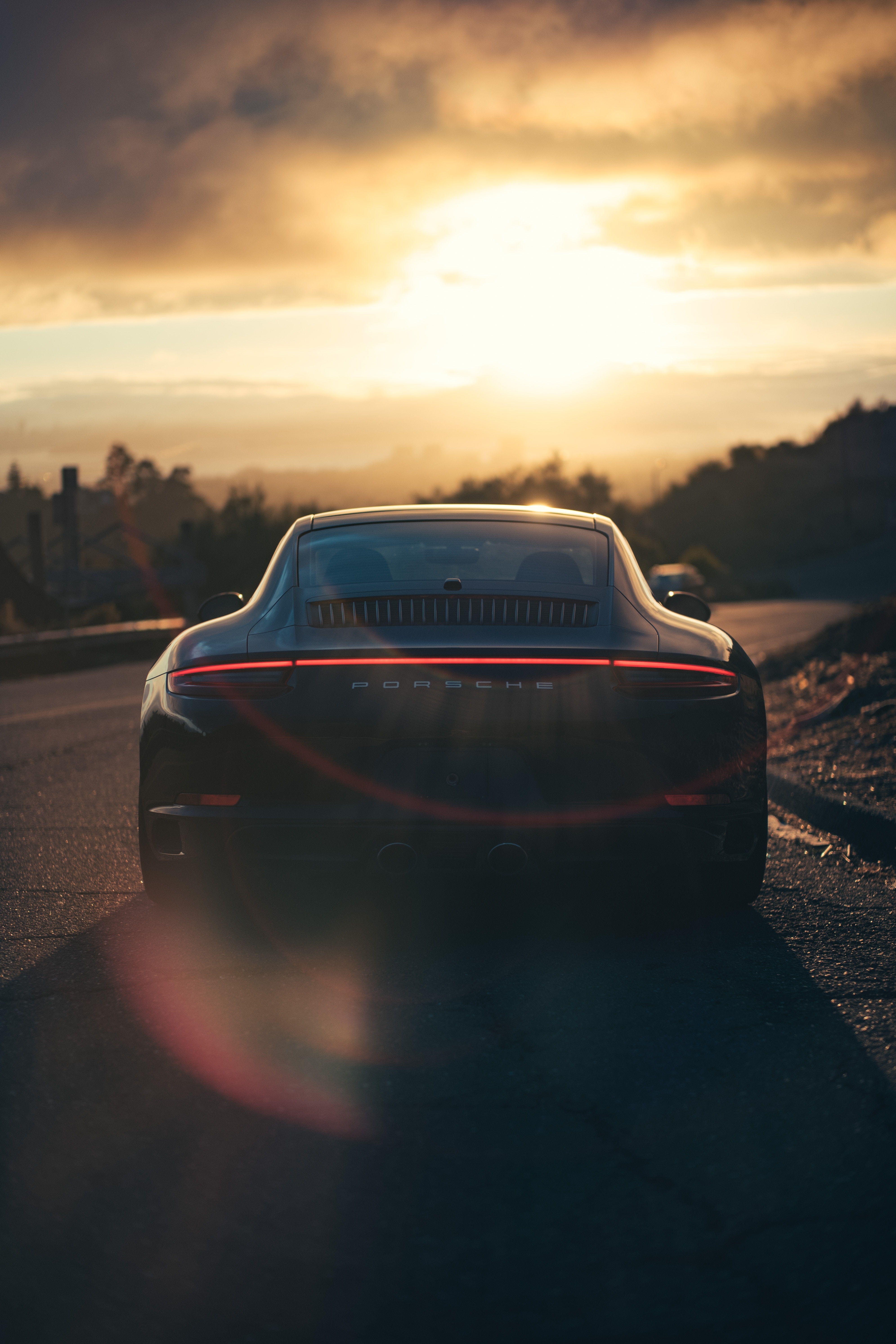 72861 download wallpaper Porsche, Sports, Cars, Traffic, Movement, Sports Car, Back View, Rear View, Sunlight screensavers and pictures for free