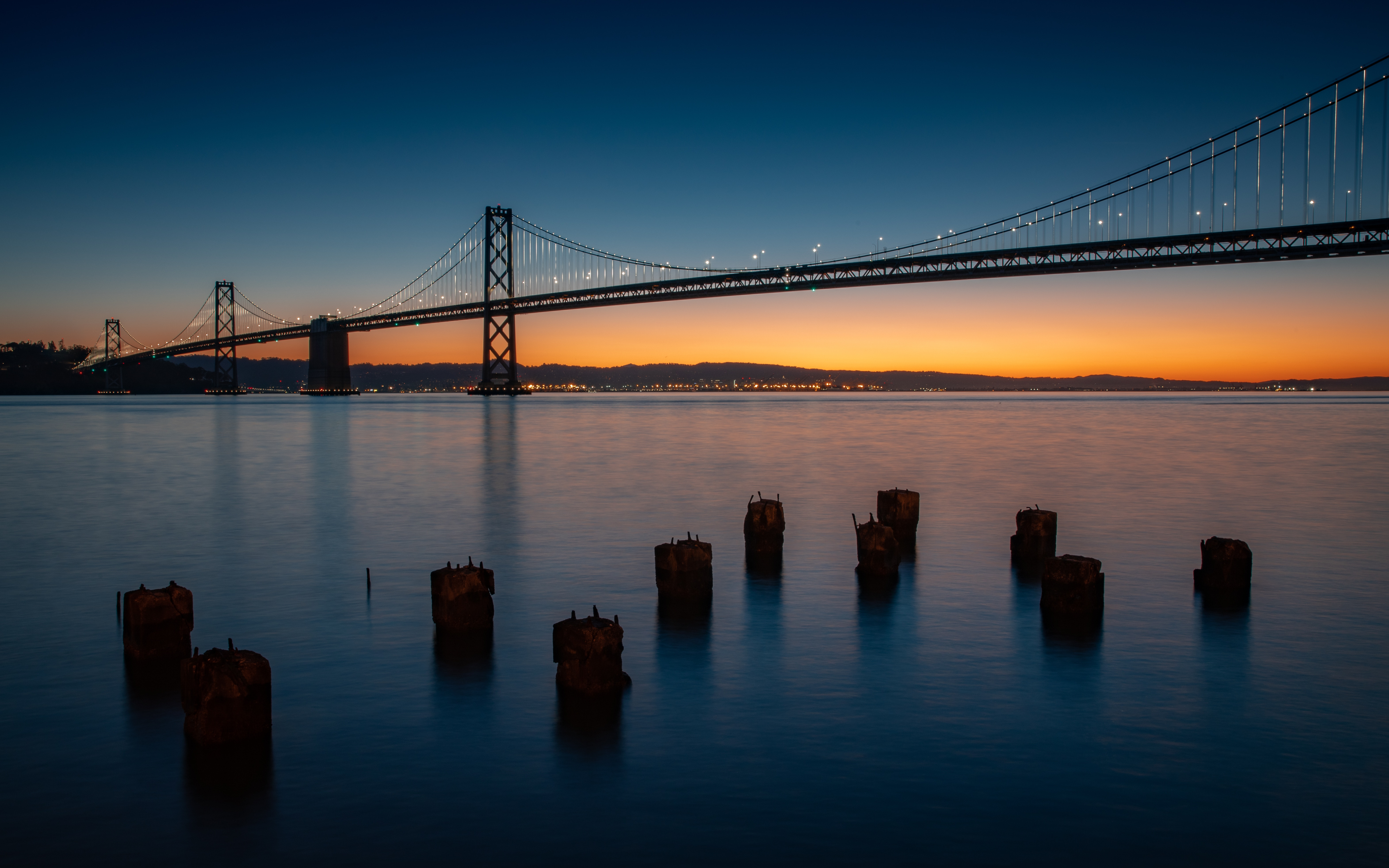 155689 Screensavers and Wallpapers Bridge for phone. Download Cities, Water, Rivers, Twilight, Dusk, Bridge, Evening, Pillars, Posts pictures for free