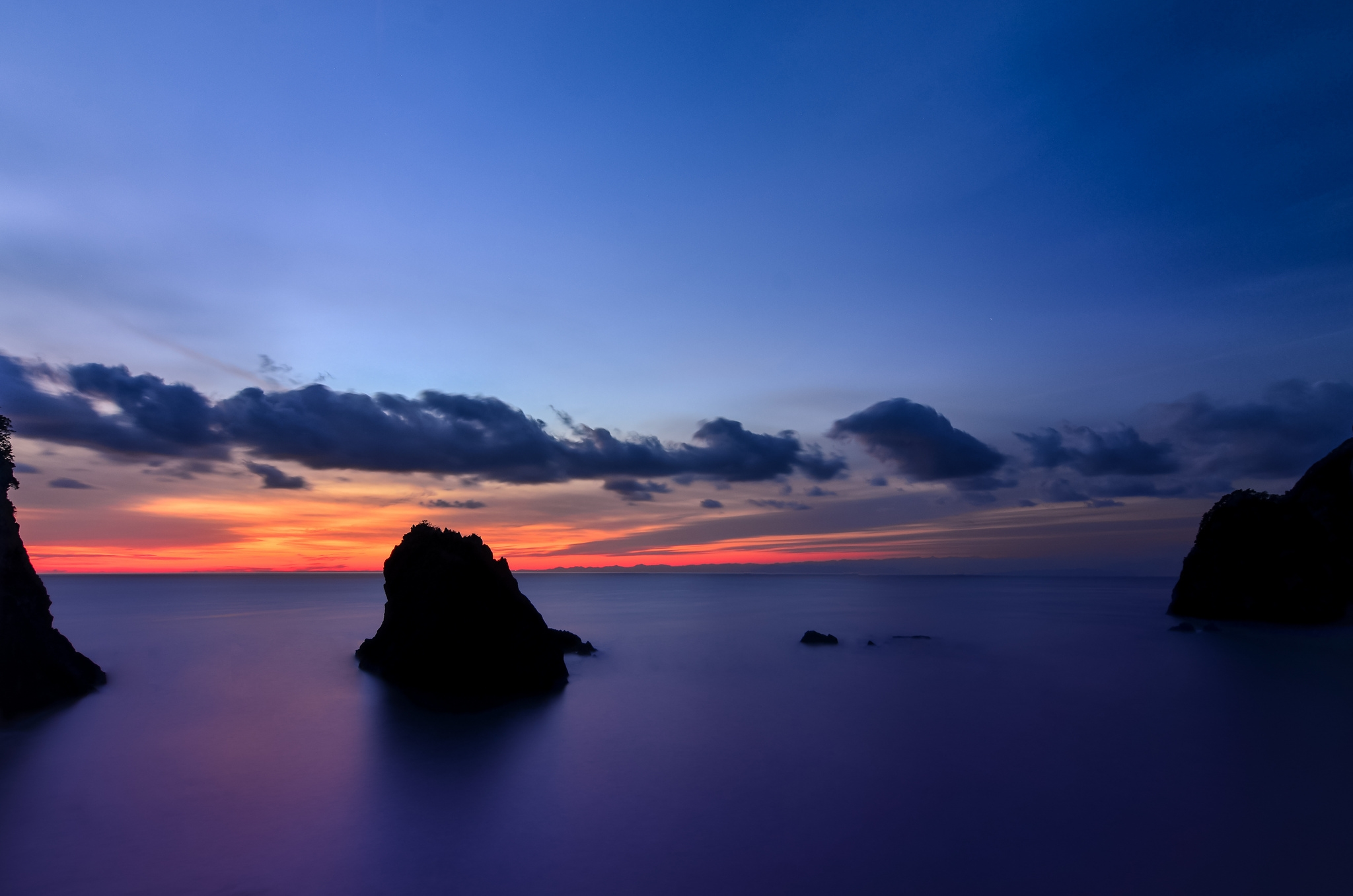 126999 Screensavers and Wallpapers Island for phone. Download Nature, Sunset, Sky, Clouds, Rocks, Shore, Bank, Ocean, Evening, Japan, Island, Calm, Shizuoka Prefecture pictures for free