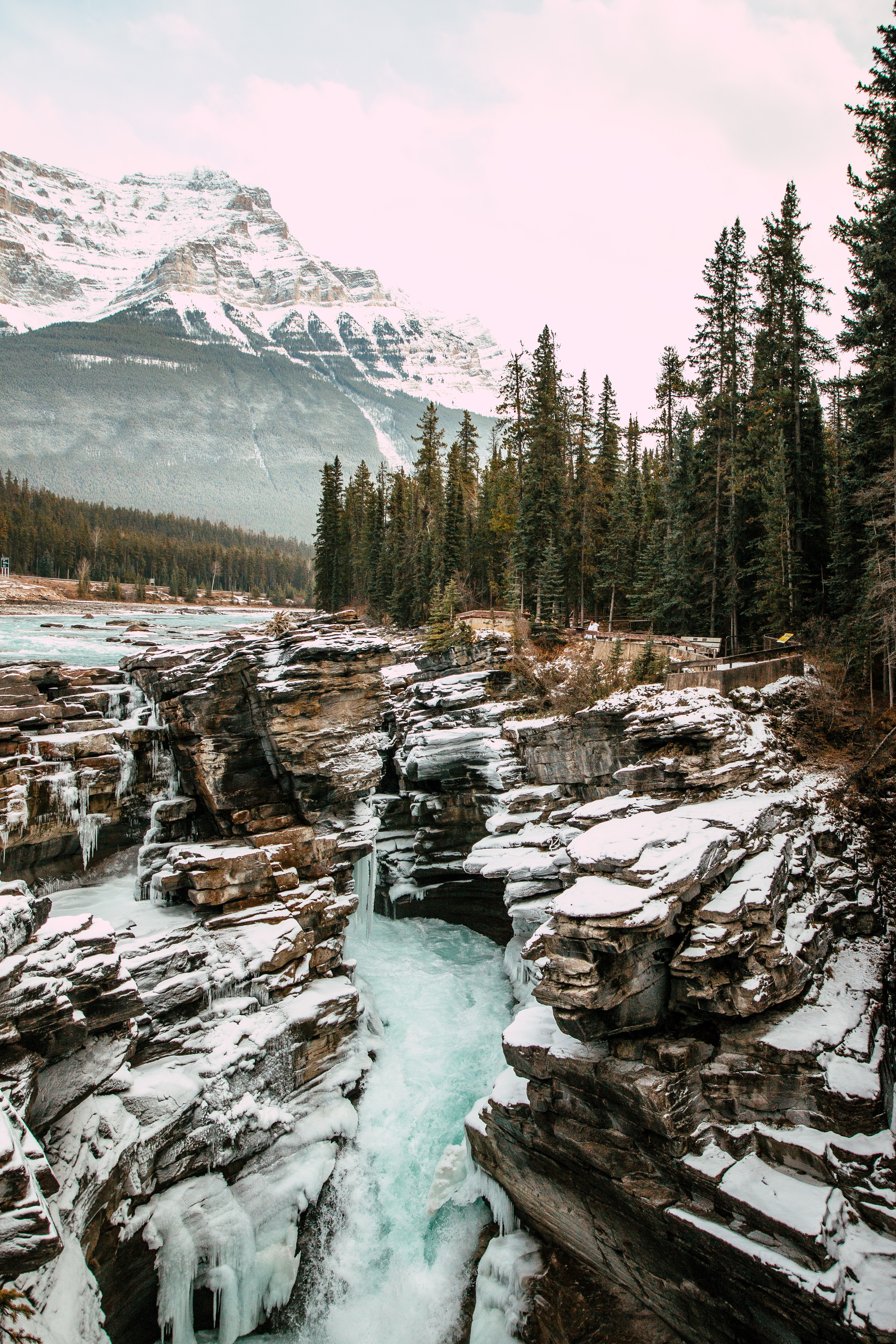 93730 download wallpaper Nature, Waterfall, Rocks, Snow, Snow Covered, Snowbound, Mountains screensavers and pictures for free