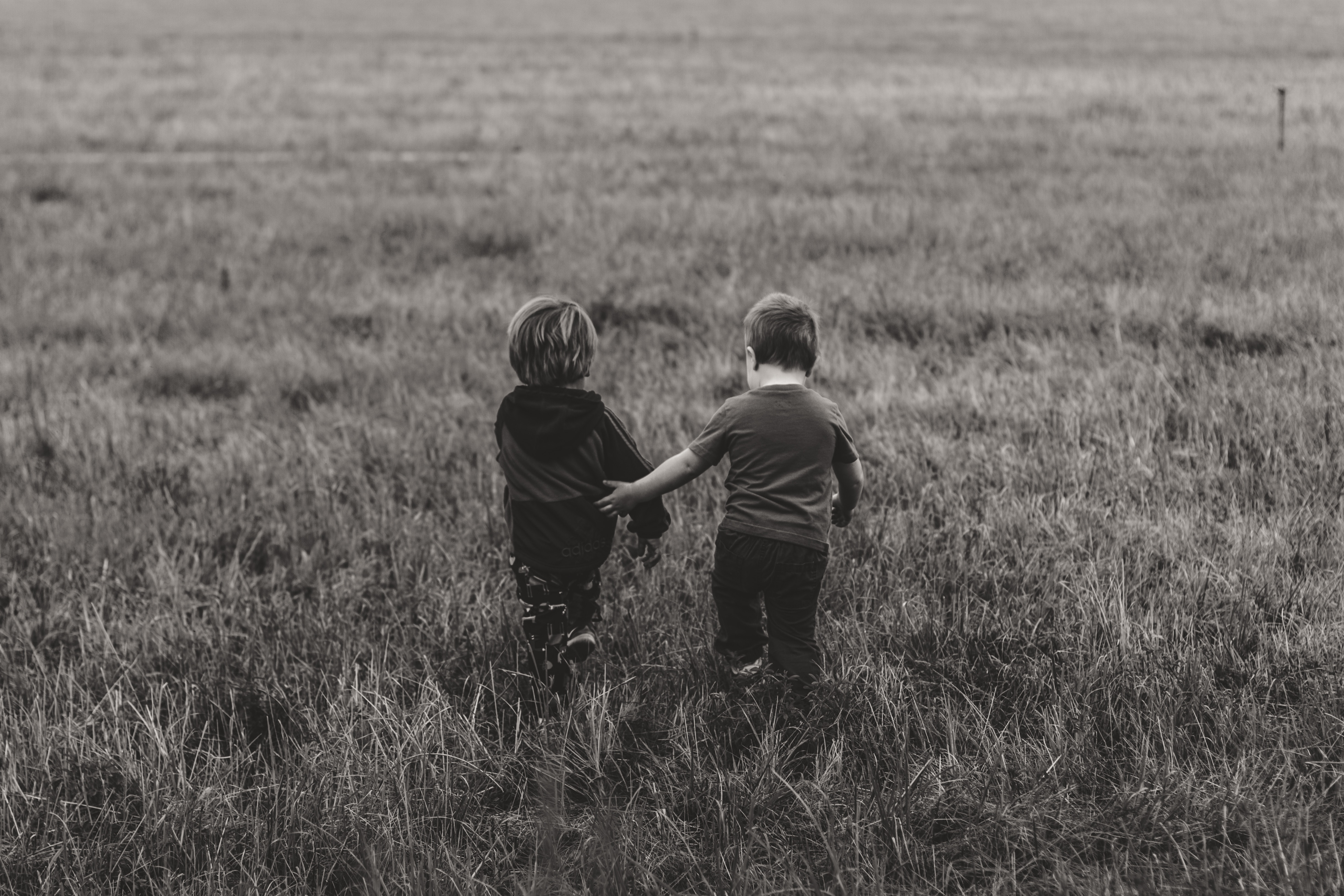 74779 Screensavers and Wallpapers Children for phone. Download Miscellanea, Miscellaneous, Children, Couple, Pair, Field, Stroll, Friendship, Bw, Chb pictures for free