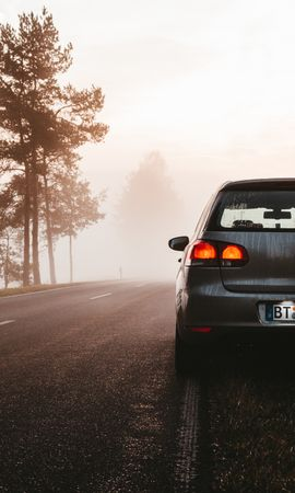 137327 Screensavers and Wallpapers Volkswagen for phone. Download Cars, Volkswagen, Fog, Car, Road, Dusk, Twilight pictures for free