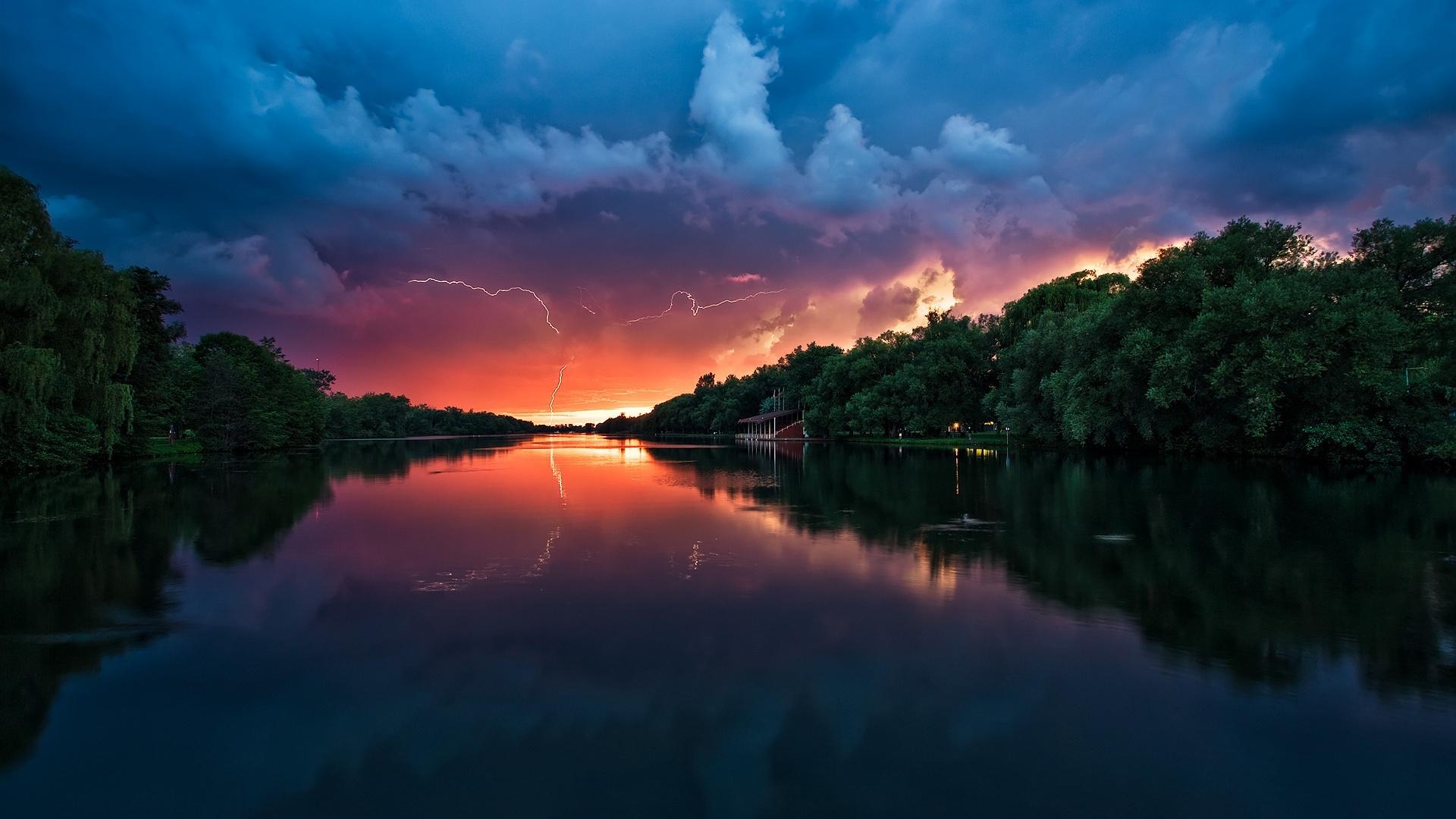 Скачать картинку Закат, Река, Пейзаж, Природа в телефон бесплатно.