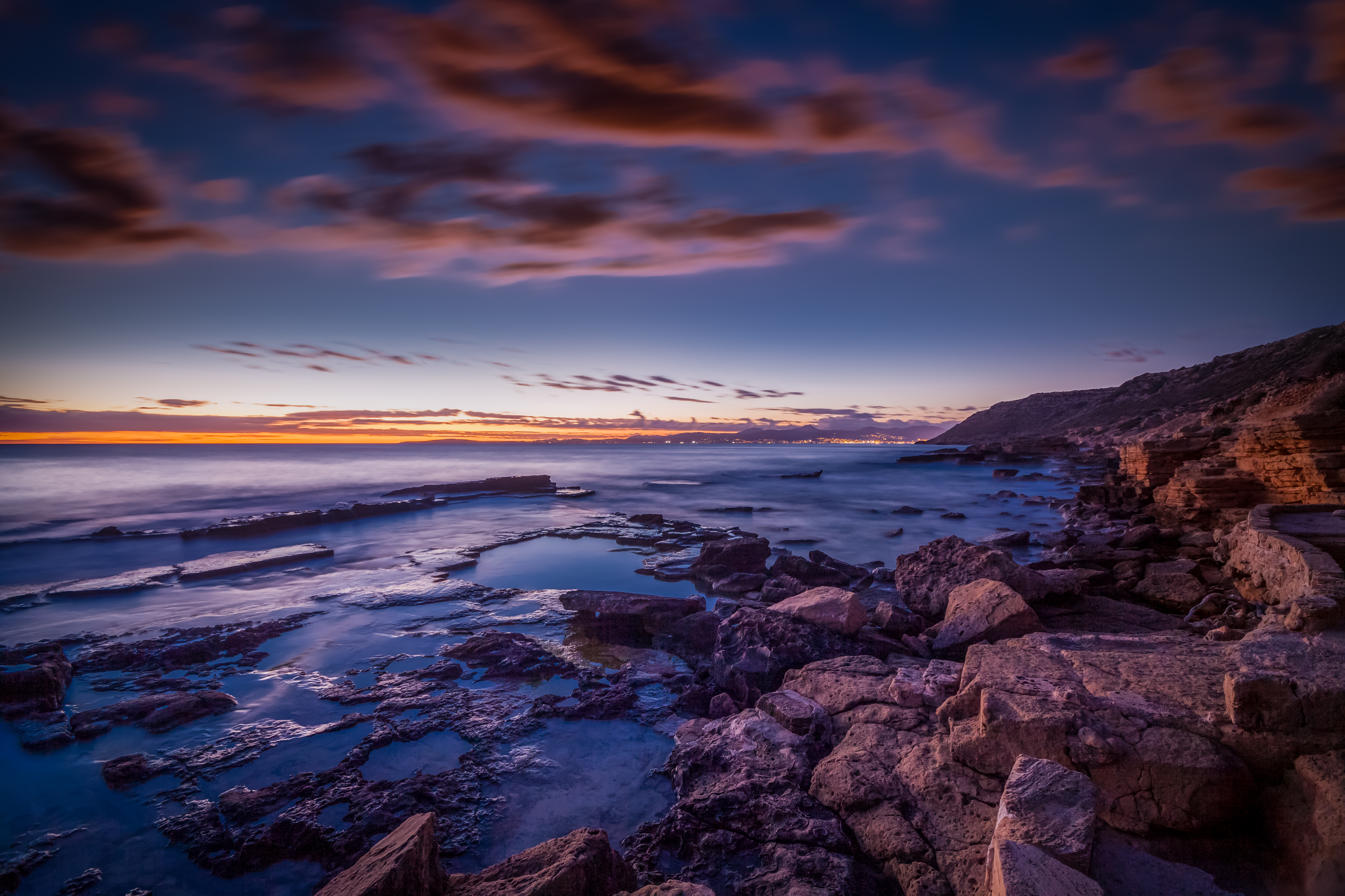 51942 download wallpaper Nature, Sea, Shore, Bank, Stones, Sunset, Spain screensavers and pictures for free