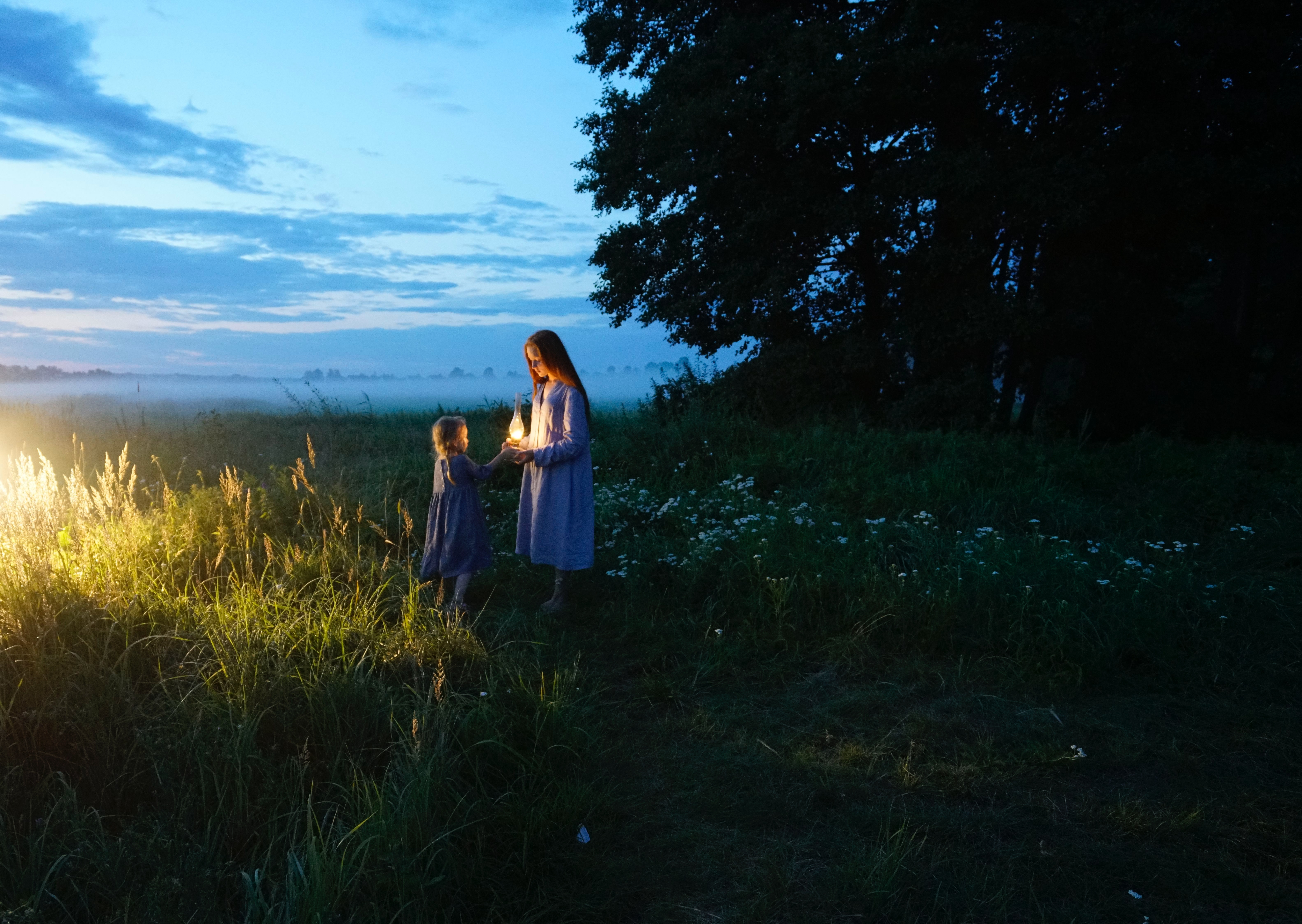 106442 download wallpaper Children, Nature, Sunset, Field, Lamp, Childhood screensavers and pictures for free