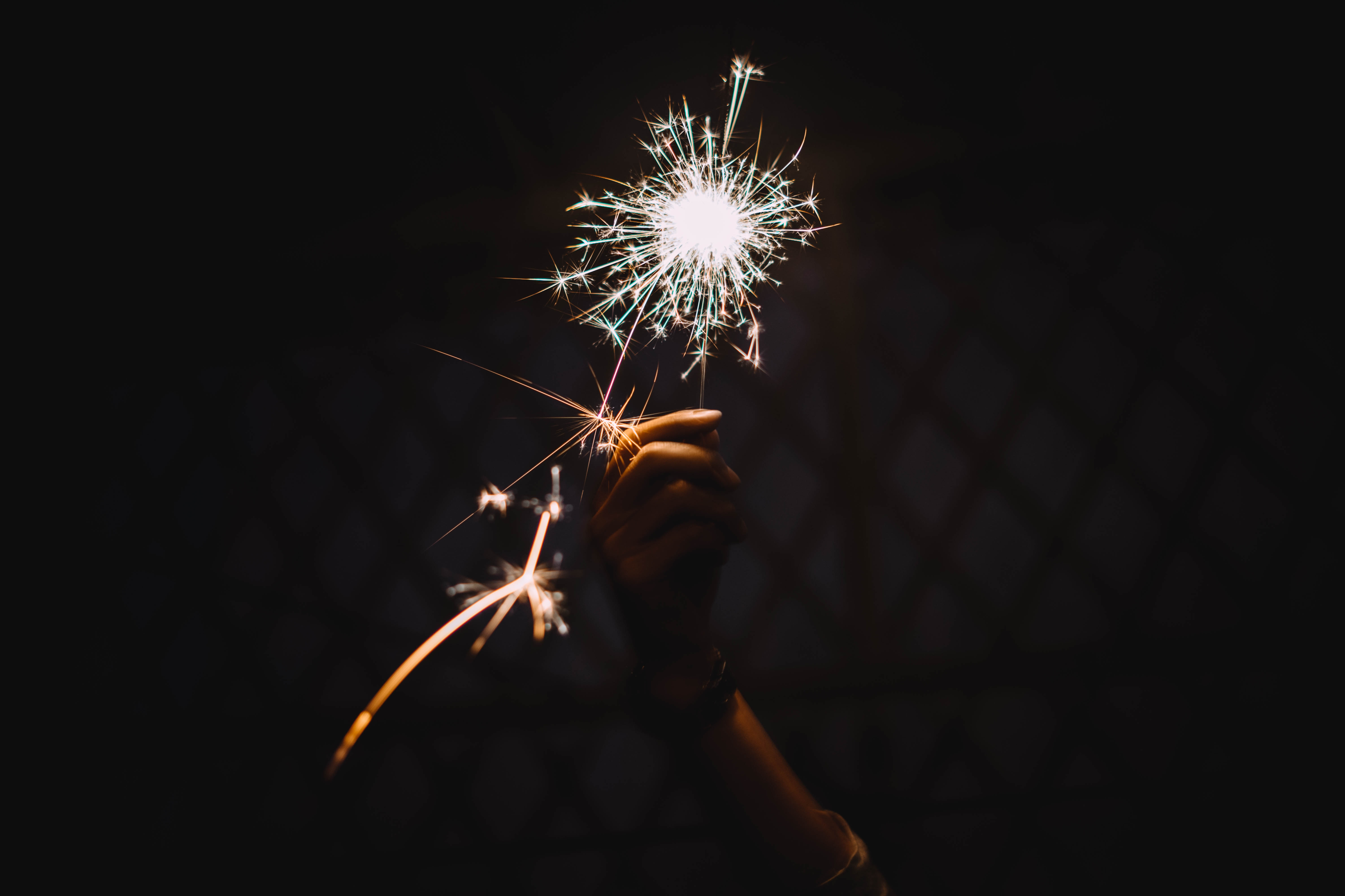 87257 Screensavers and Wallpapers Hand for phone. Download Miscellanea, Miscellaneous, Sparkler, Hand, Shine, Brilliance pictures for free