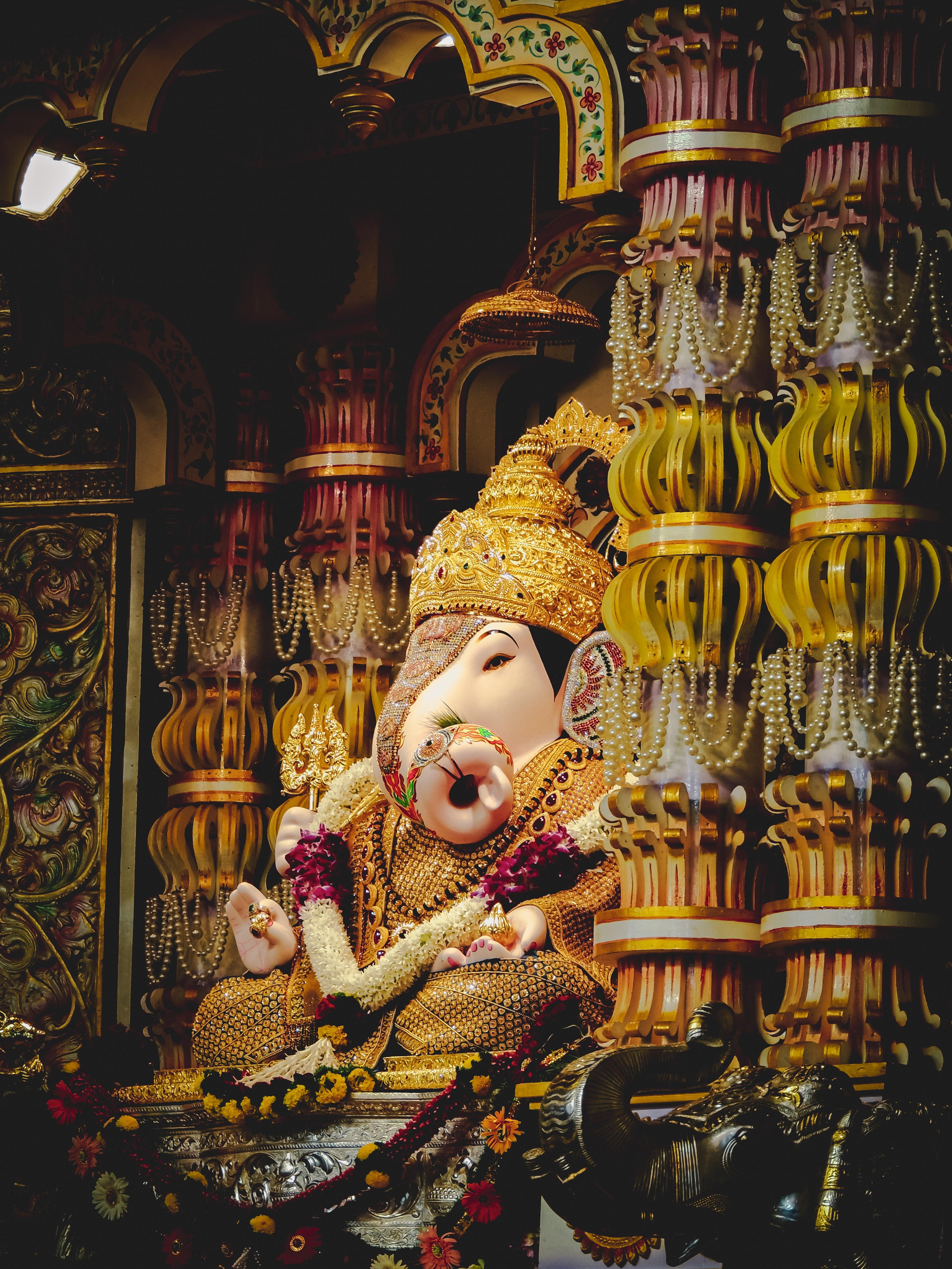 58425 free wallpaper 1080x1920 for phone, download images God, Ganesha, Gold, Miscellanea, Miscellaneous, Statuette, Golden, Deity, Column, Columns, Religion 1080x1920 for mobile