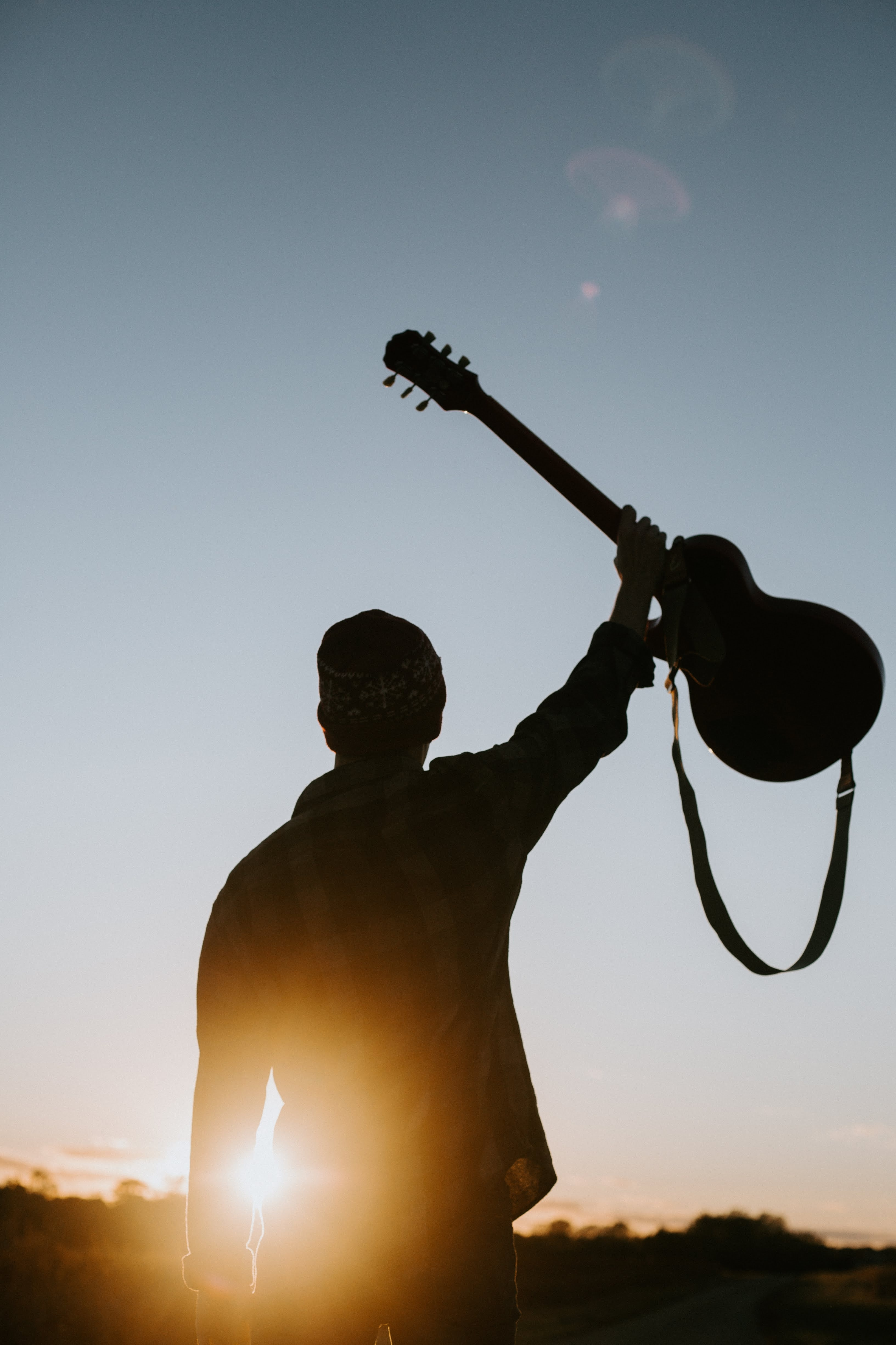 114002 download wallpaper Miscellanea, Miscellaneous, Guitar, Silhouette, Beams, Rays, Sun screensavers and pictures for free
