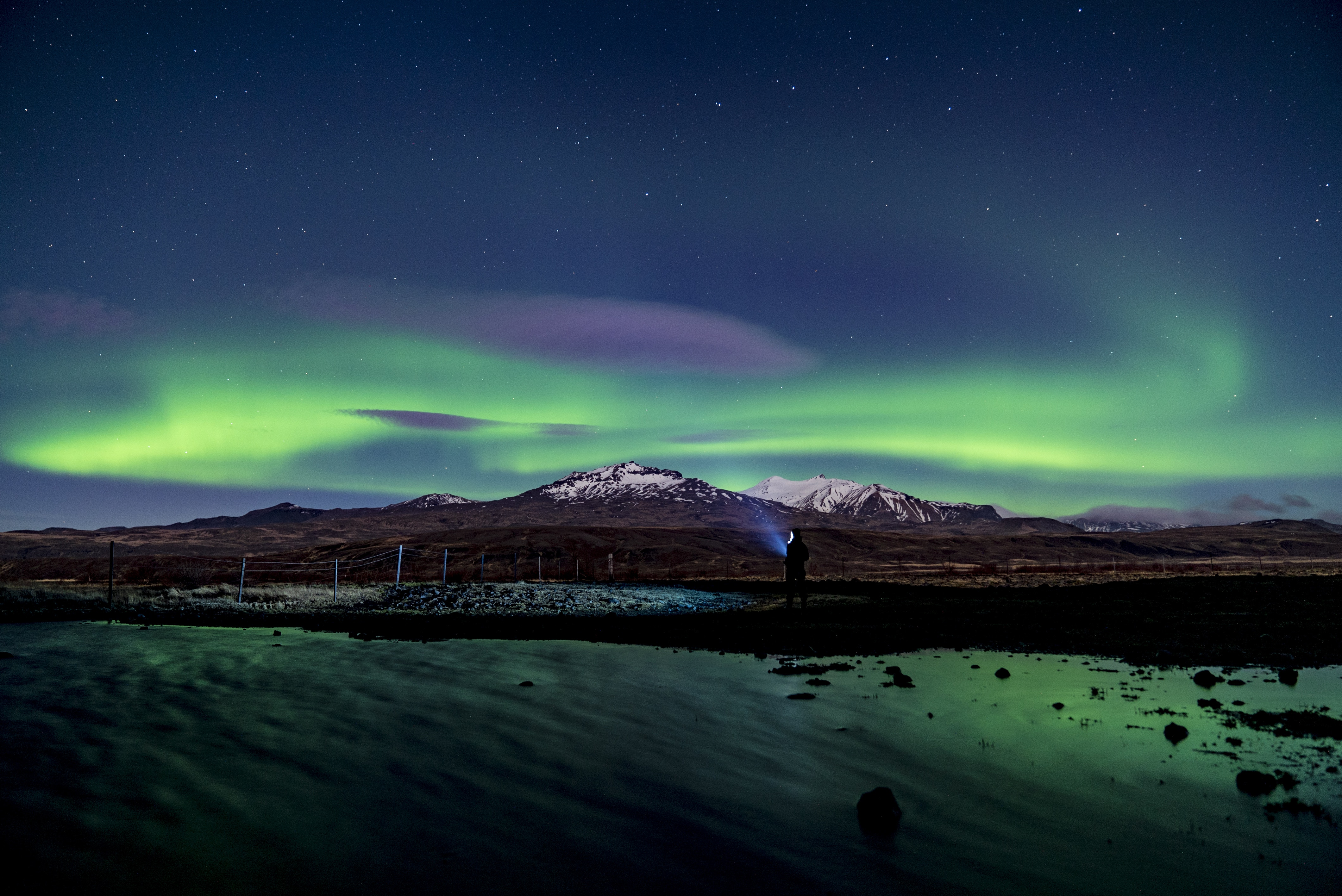 157748 download wallpaper Nature, Northern Lights, Aurora Borealis, Aurora, Silhouette, Snow, Winter, Starry Sky, Night, Mountains screensavers and pictures for free