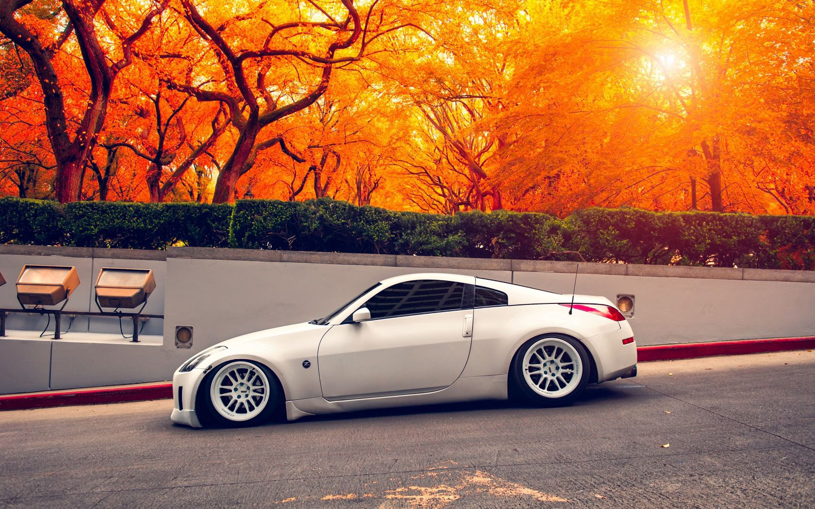 143479 Screensavers and Wallpapers Nissan for phone. Download Sports, Autumn, Nissan, Cars, Sports Car, Side View, Stance, 350Z pictures for free