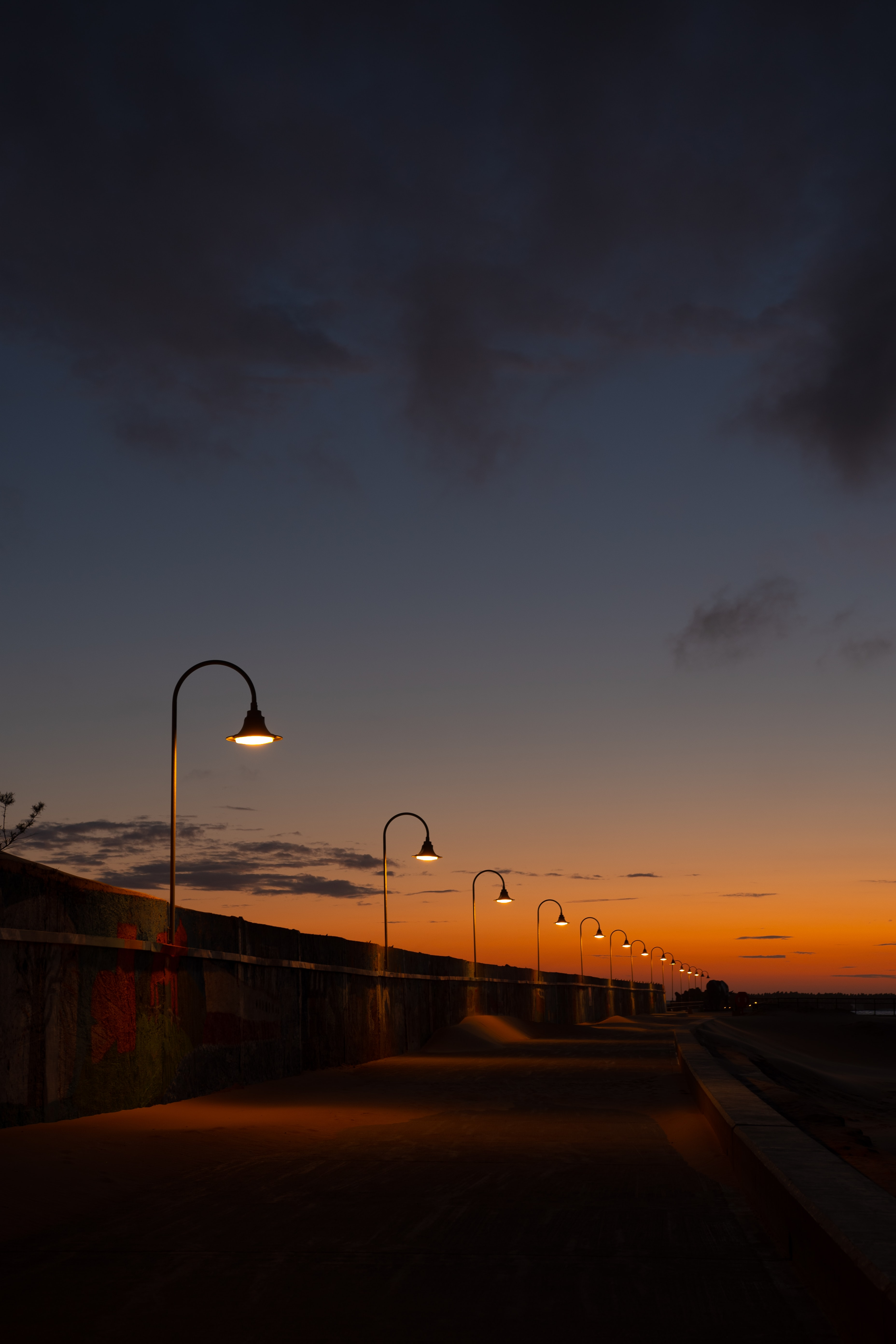 113641 free wallpaper 2160x3840 for phone, download images Cities, Sunset, Lights, Road, Lanterns, Evening 2160x3840 for mobile