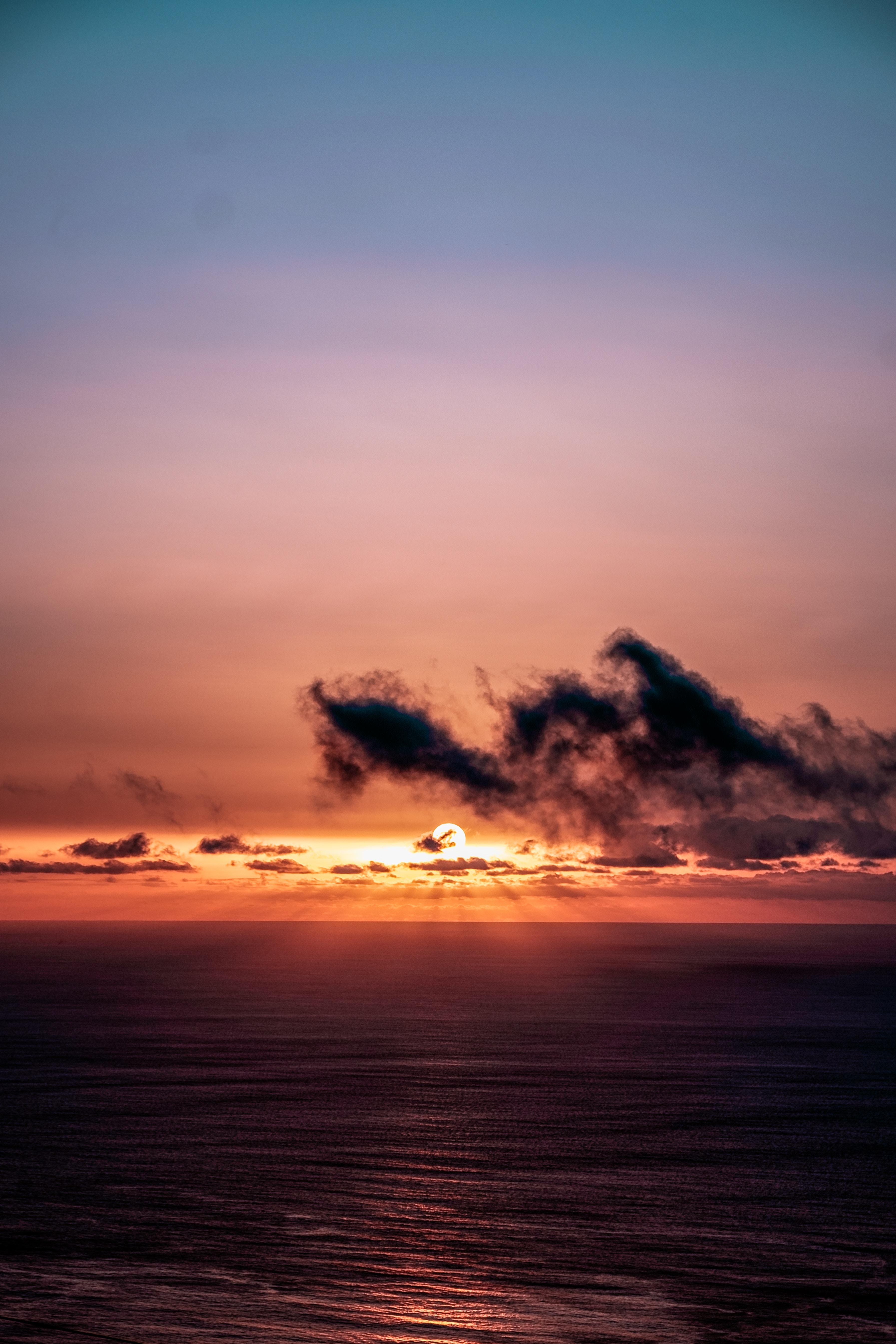 140491 Заставки и Обои Солнце на телефон. Скачать Природа, Закат, Небо, Море, Солнце, Облака, Горизонт, Темный картинки бесплатно