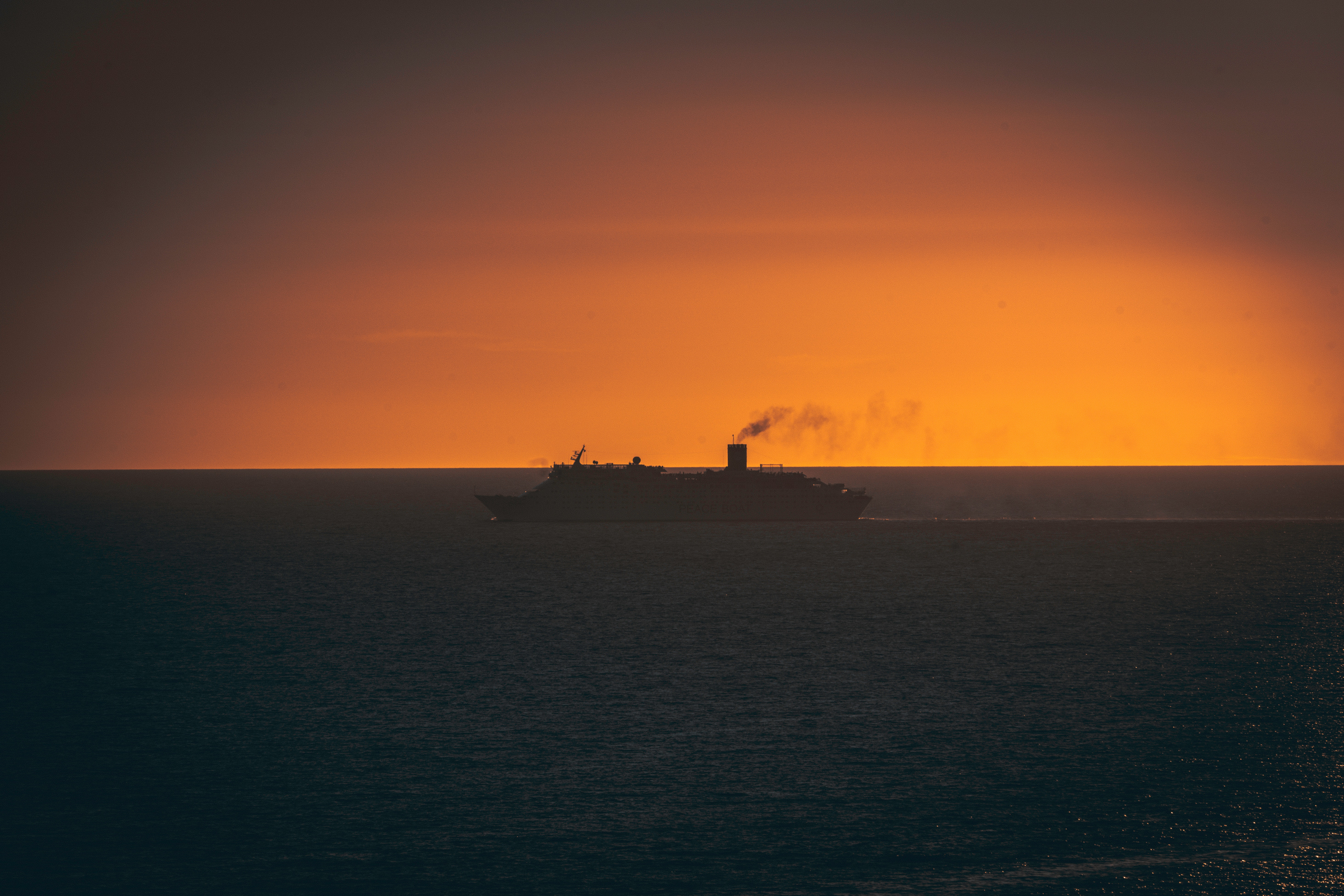 99206 download wallpaper Nature, Sunset, Swimming, Horizon, Ship screensavers and pictures for free