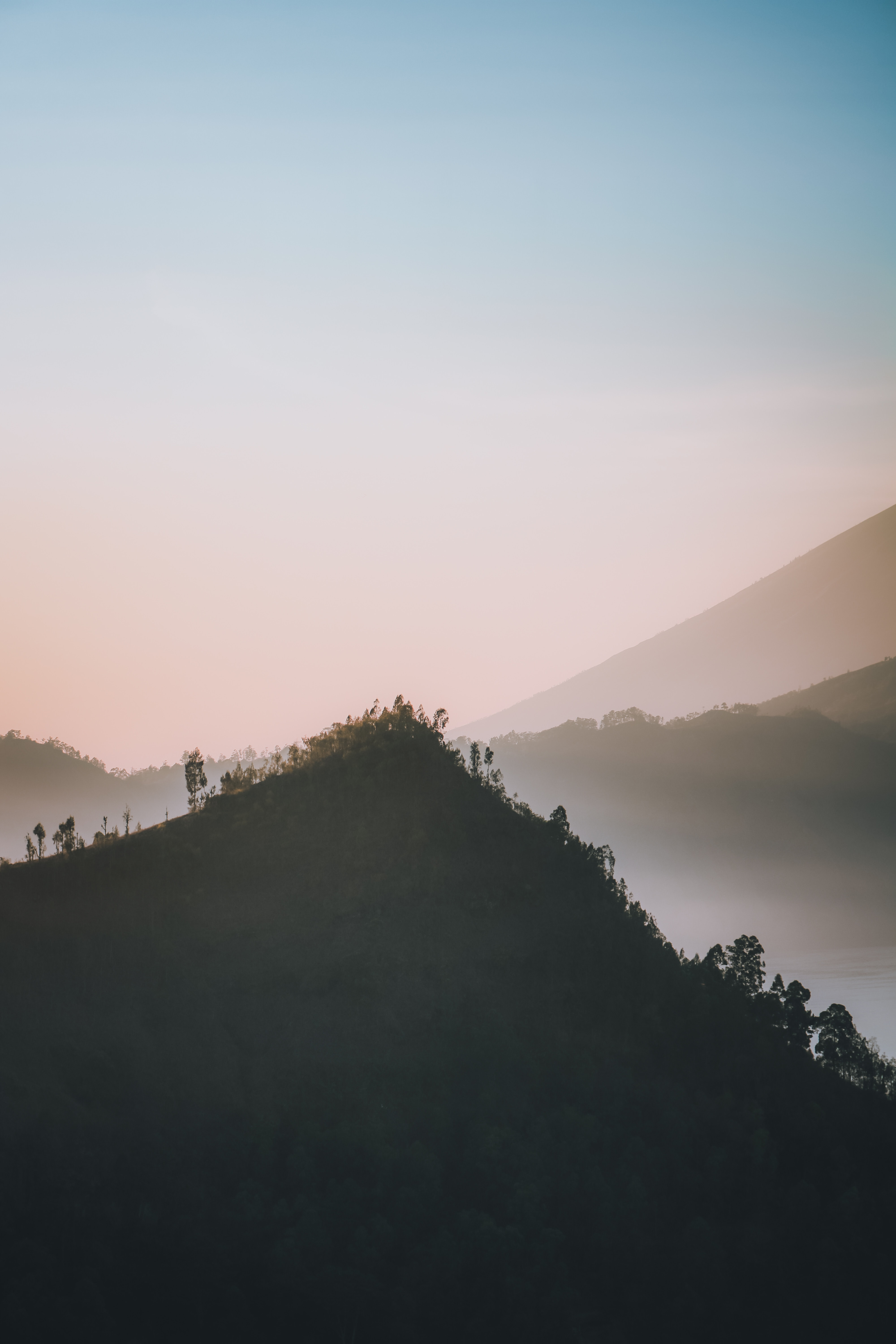 123952 download wallpaper Nature, Mountain, Vertex, Top, Fog, Dusk, Twilight, Landscape screensavers and pictures for free