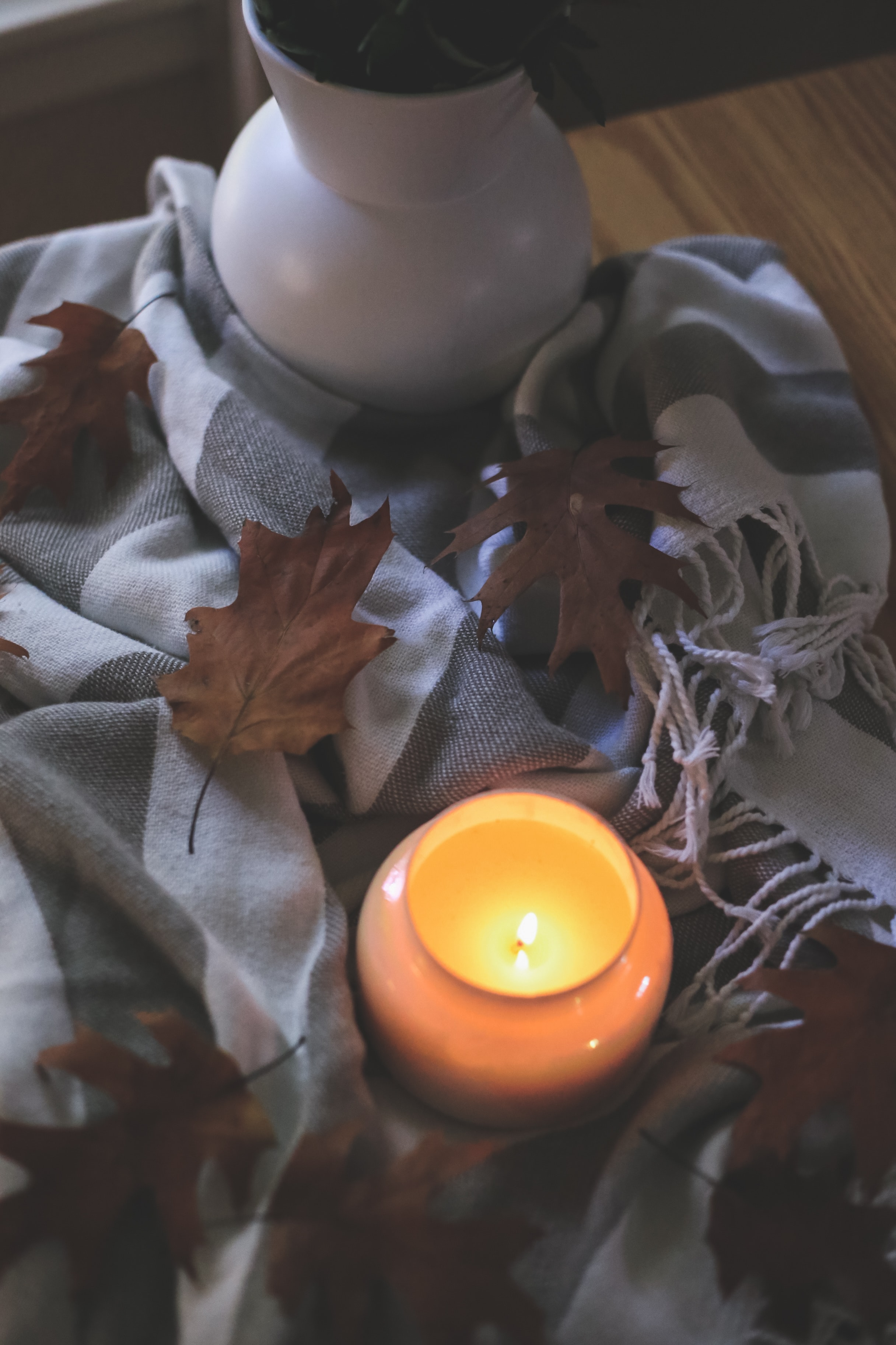 119073 download wallpaper Miscellanea, Miscellaneous, Candle, Leaves, Autumn, Cloth, Flame screensavers and pictures for free