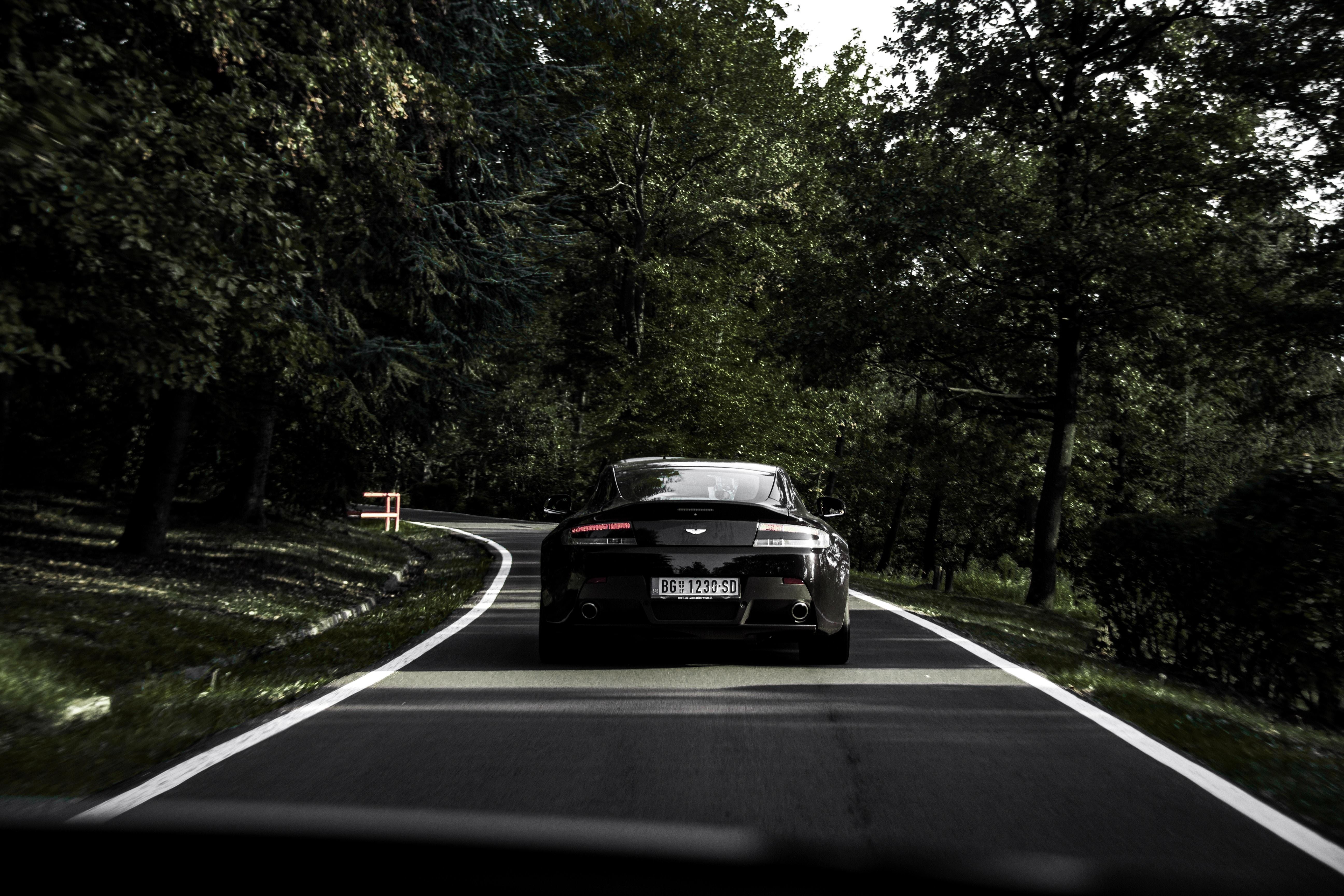 147911 Заставки и Обои Астон Мартин (Aston Martin) на телефон. Скачать Астон Мартин (Aston Martin), Тачки (Cars), Дорога, Черный, Машина картинки бесплатно