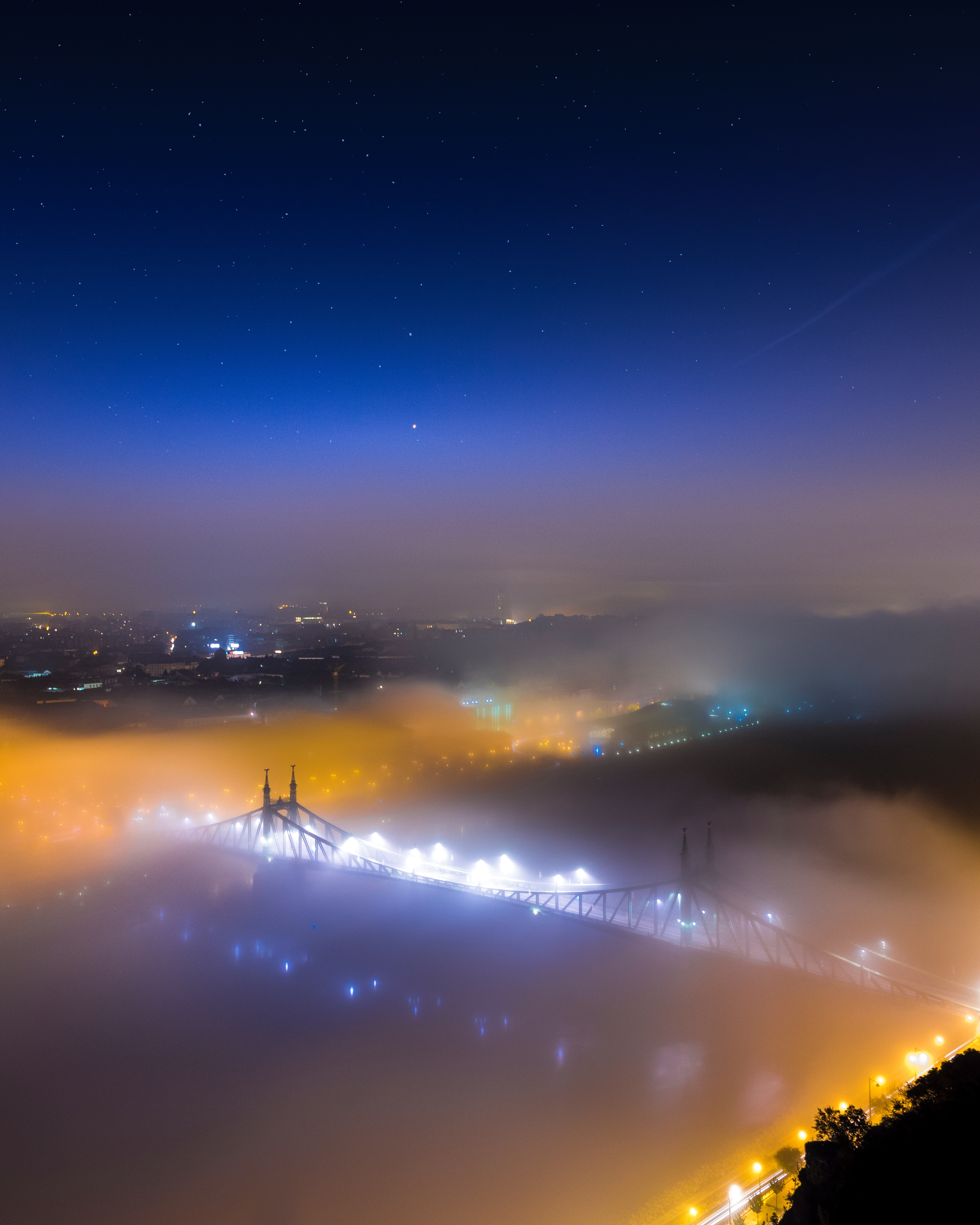 79188 Screensavers and Wallpapers Night City for phone. Download Nature, View From Above, Fog, Night City, Bridge, Hungary, Budapest pictures for free