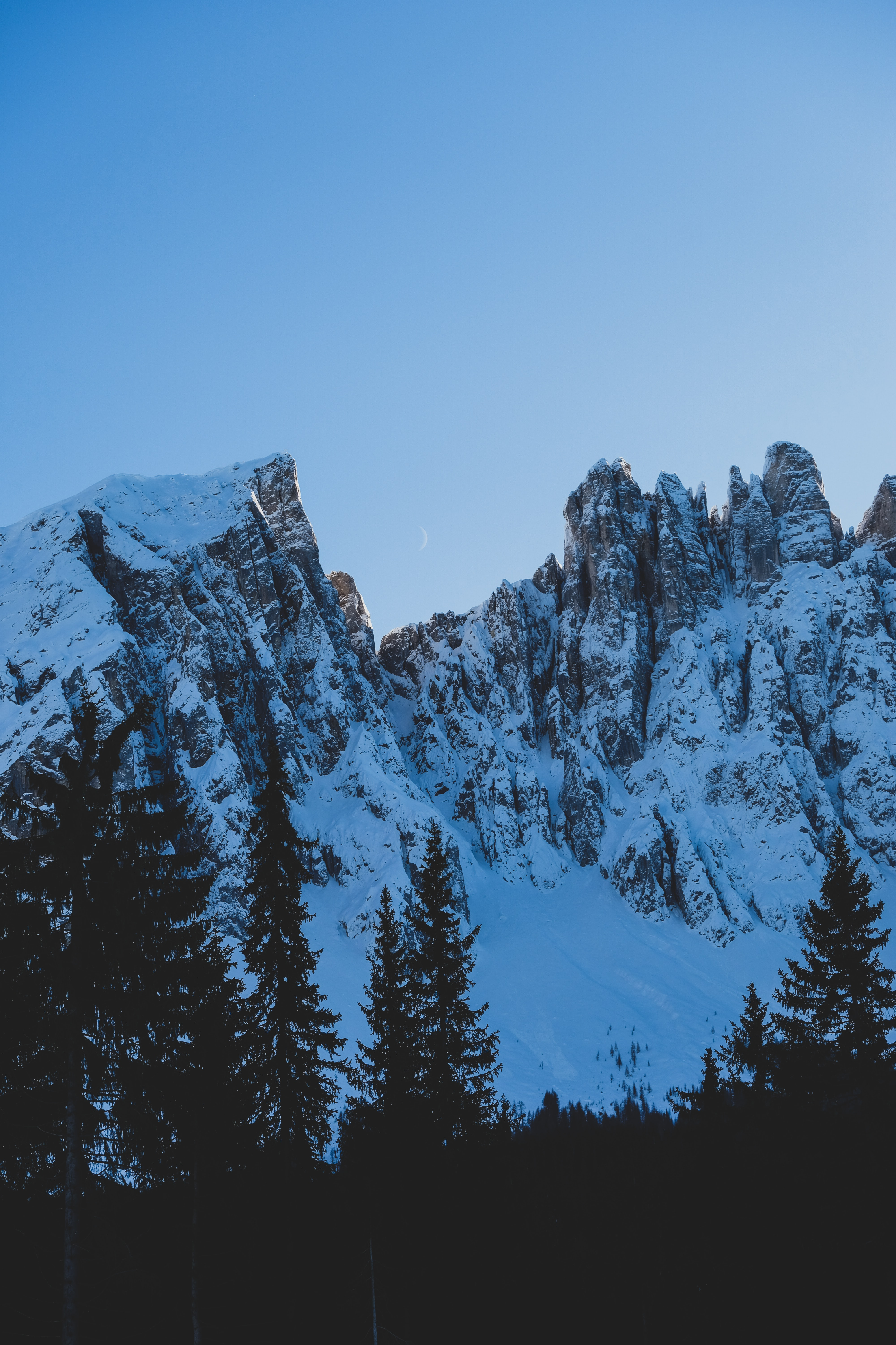 123494 download wallpaper Nature, Rocks, Snow, Snow Covered, Snowbound, Spruce, Fir, Moon, Mountains screensavers and pictures for free