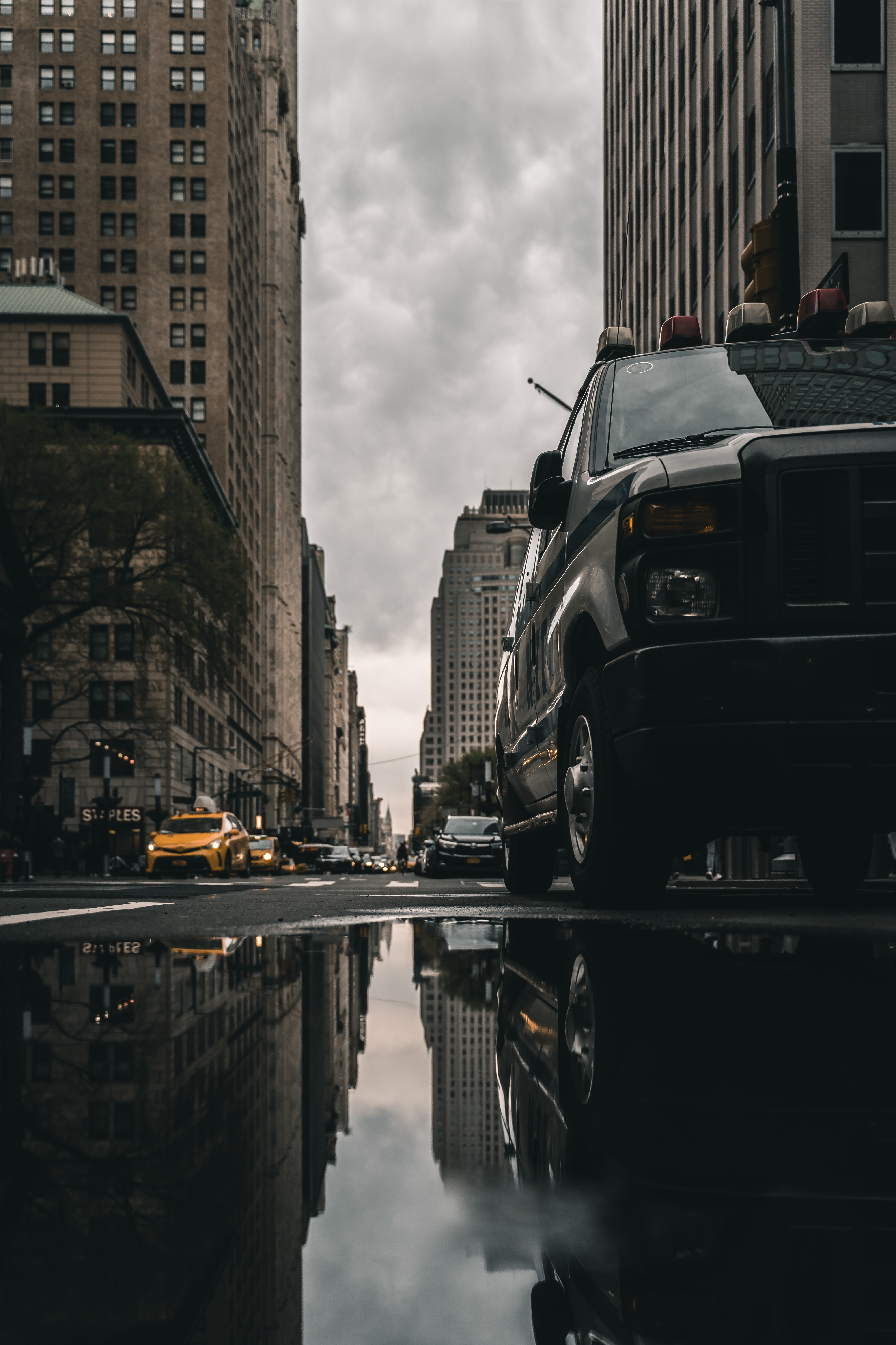 105563 Screensavers and Wallpapers Cities for phone. Download Cities, Building, Cars, Reflection, Asphalt, Street, Puddle pictures for free